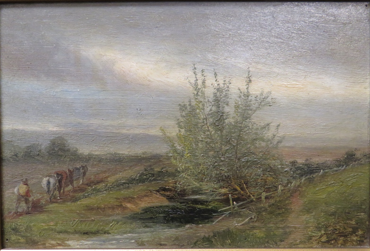 Lot 47 - Landscape with horses and drover, oil on board, unsigned, (15cm x 22.5cm) in a moulded gilt gesso