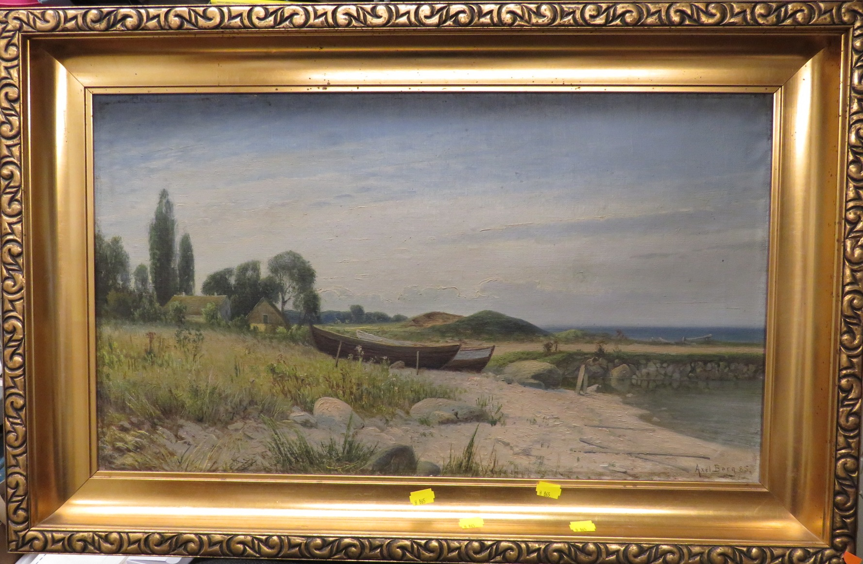 Lot 37 - Shore with rowing boats and cottage, oil on canvas, signed Axel Berg and dated 85 lower right, in
