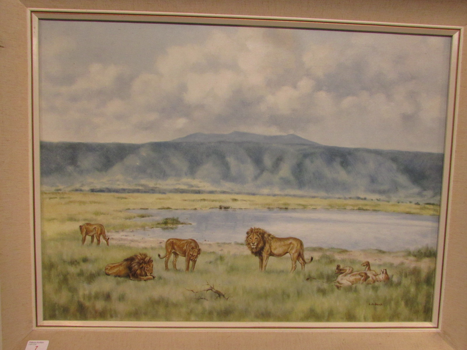 Lot 7 - African landscape with lions, oil on canvas, signed L de Burgh lower right, (55cm x 75cm), in a