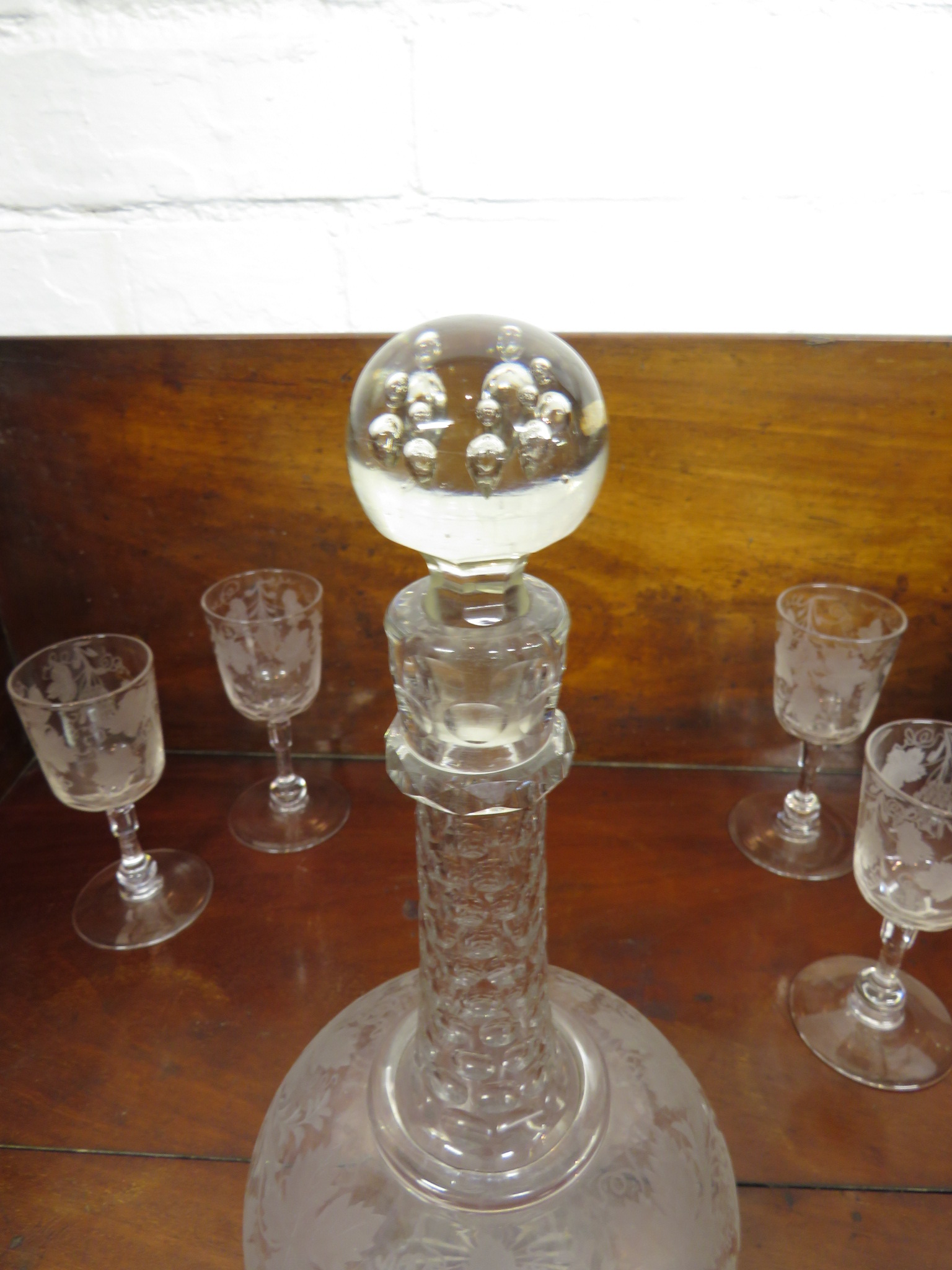 Lot 119 - Four 19th century wine glasses, the bowls etched with vines, the stem with bulb above the foot and