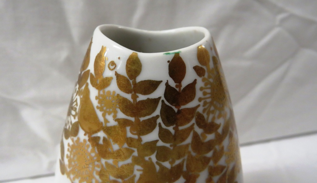 Lot 69 - Rosenthal vase of flattened ovoid form, white porcelain gilded with man and woman amongst birds,