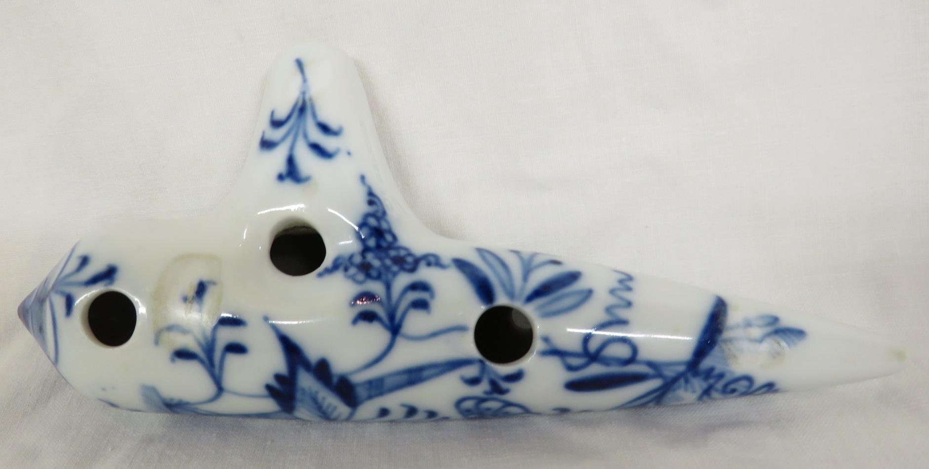Lot 70 - Porcelain ocarina with underglaze blue foliate decoration, stamped MEISSEN 5D, length 18cm