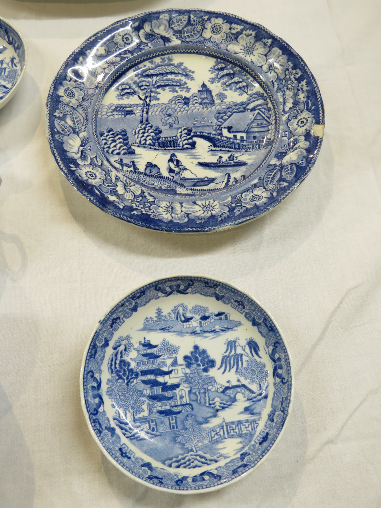 Lot 109 - A small assortment of blue and white transfer decorated pottery - an oval dish, a pierced meat
