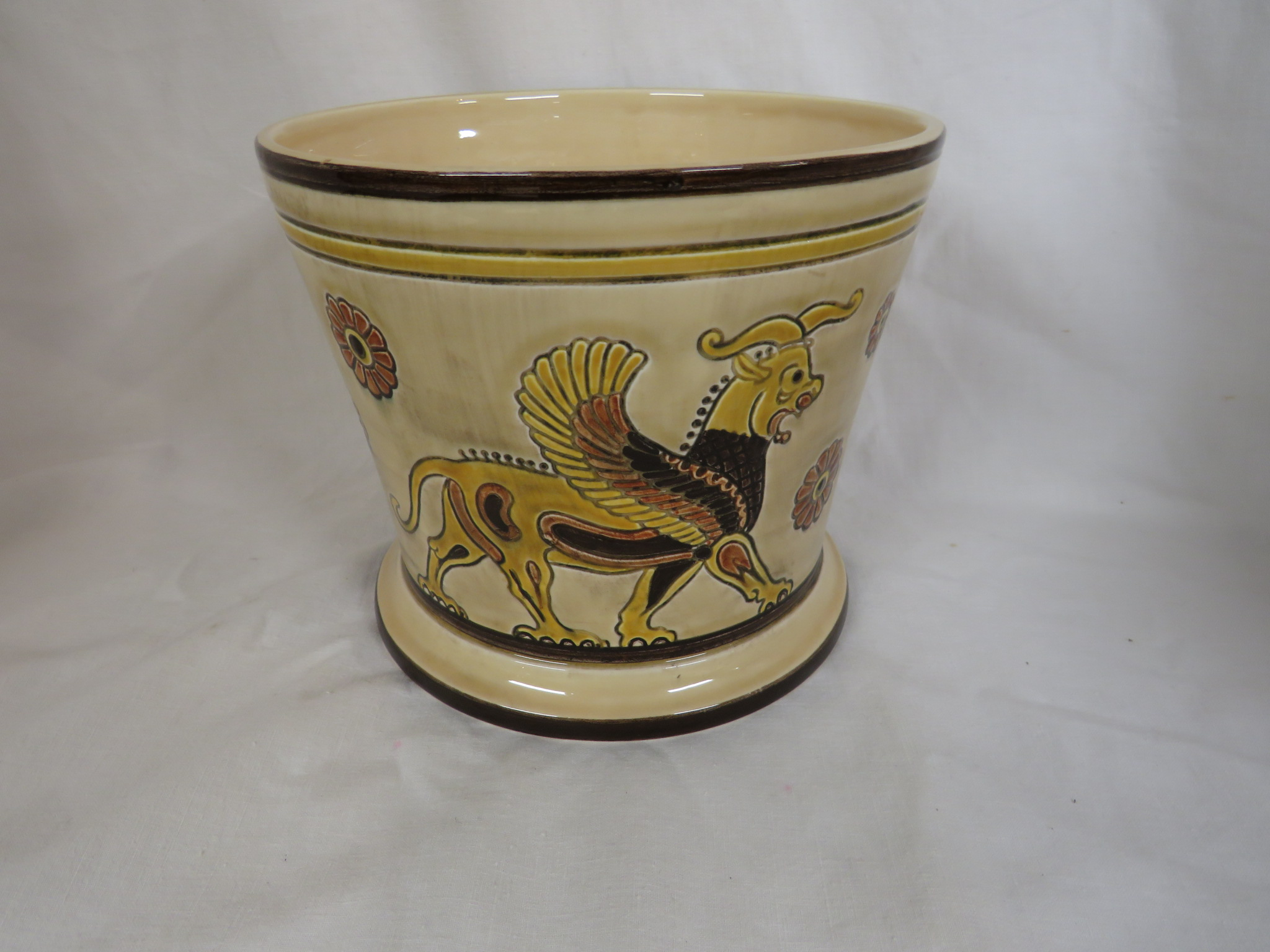 Lot 97 - Sylvac pottery Assyrian pattern - two vases, decorated in browns and yellows with winged beasts