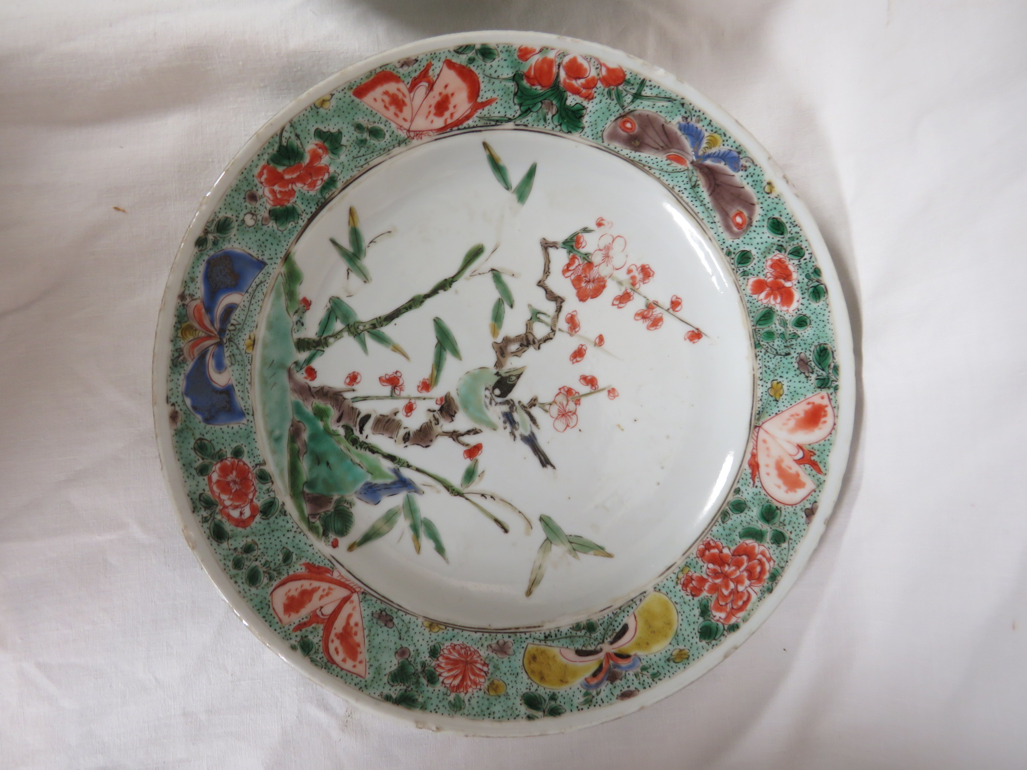 Lot 102 - Two Chinese porcelain plates enamelled in the famille verte palette with flowering branch and