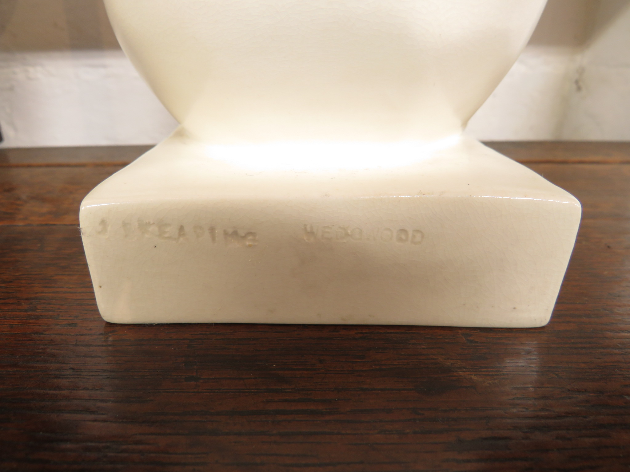 Lot 83 - Wedgwood Etruria pottery model of a polar bear by John Skeaping, cream colour, the bear is seated on