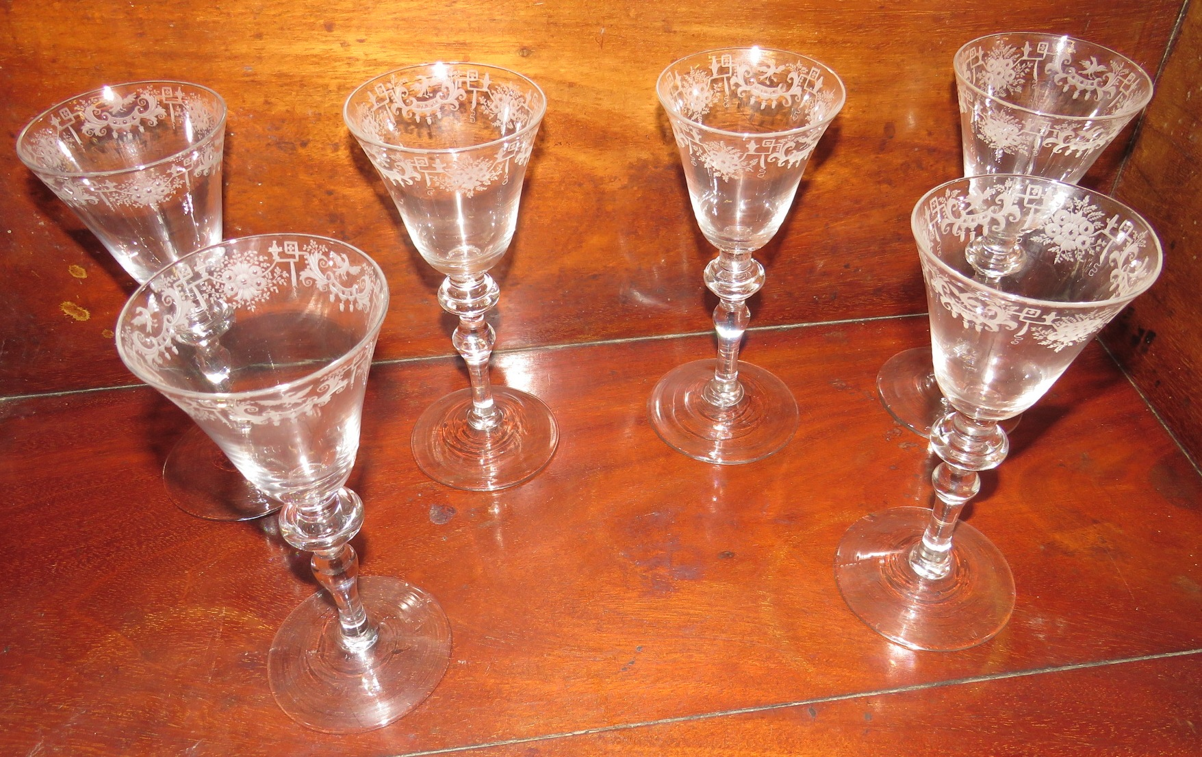 Lot 120 - Six goblets with conical bowls etched towards the mouth with a border of geometric lines and
