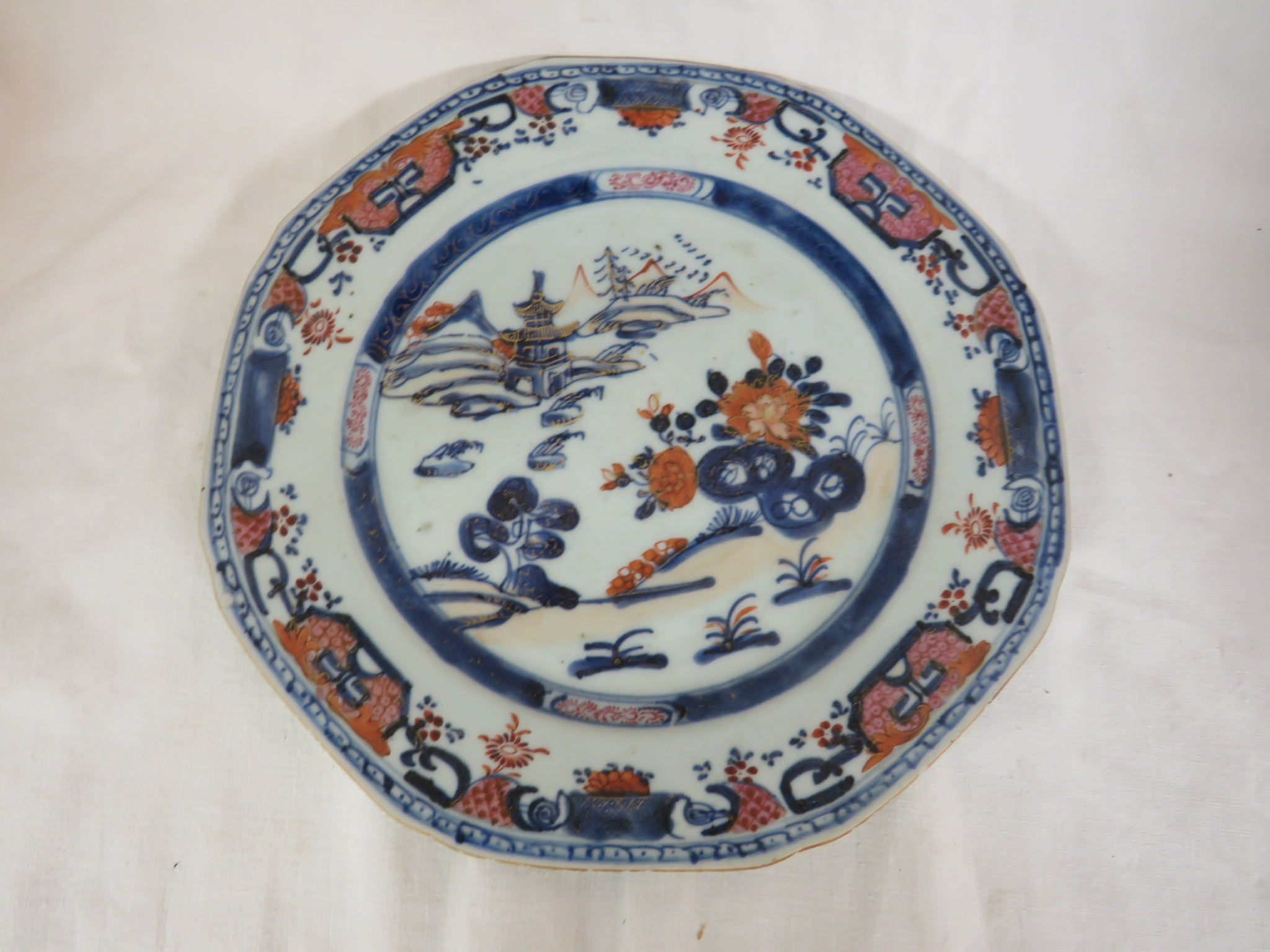 Lot 106 - Two Chinese porcelain plates - the first with a wavy rim and extensive decoration in polychrome