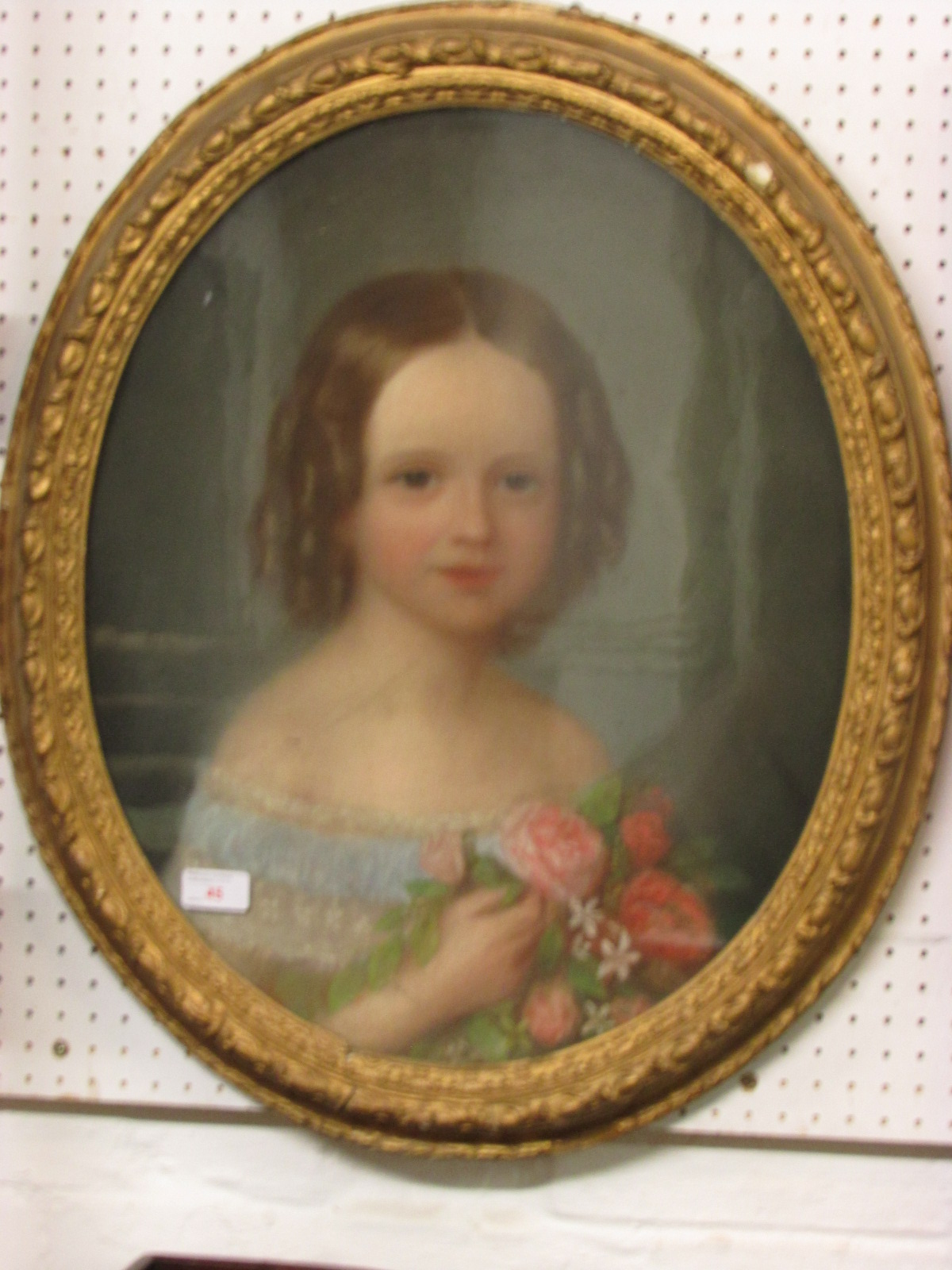Lot 45 - Pastel portrait of girl holding roses, unsigned, probably 19th century, (53cm x 43cm) glazed and