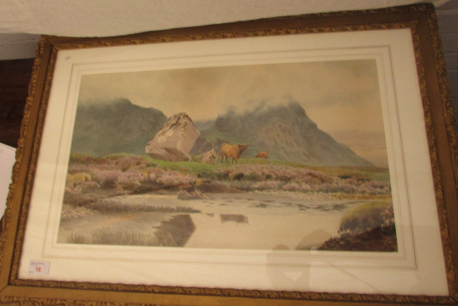 Lot 16 - Moorland landscape with cattle and boulders, watercolour, signed Wynne lower left, (31cm x 53cm)