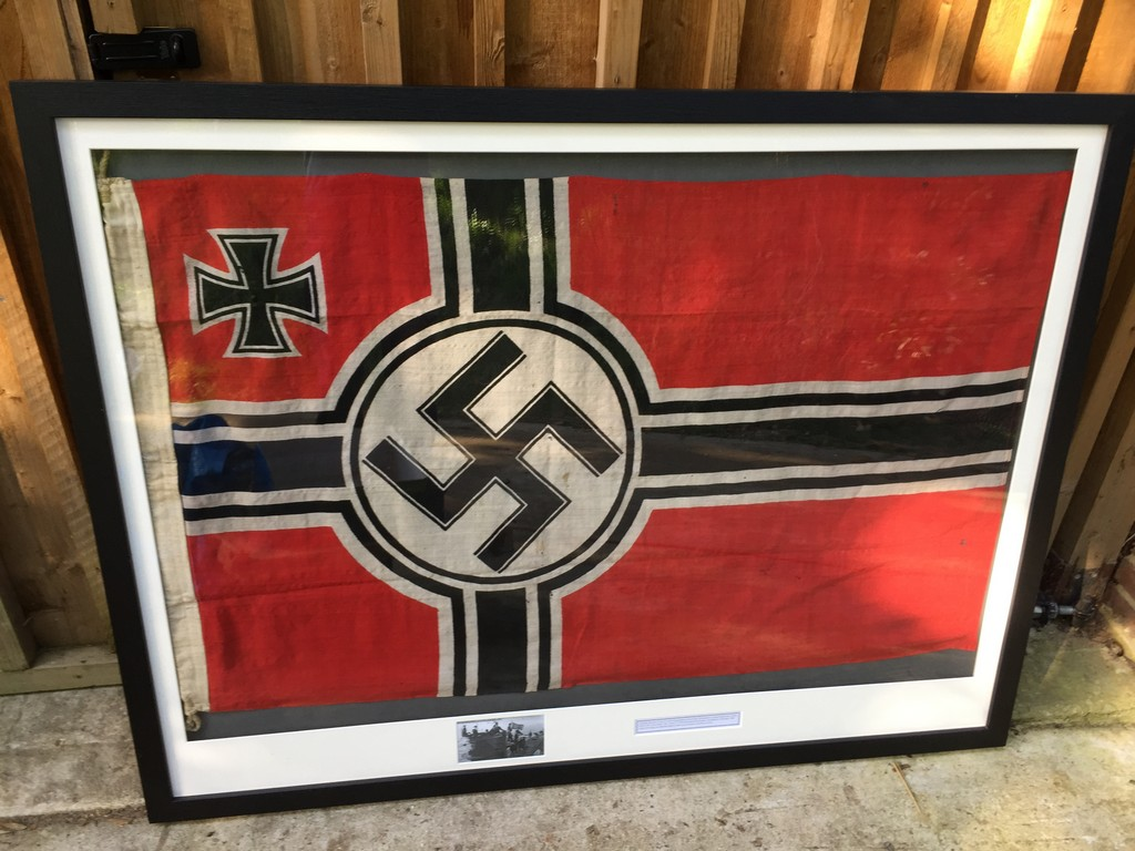 Framed and glazed German WW2 U-boat flag captured from U
