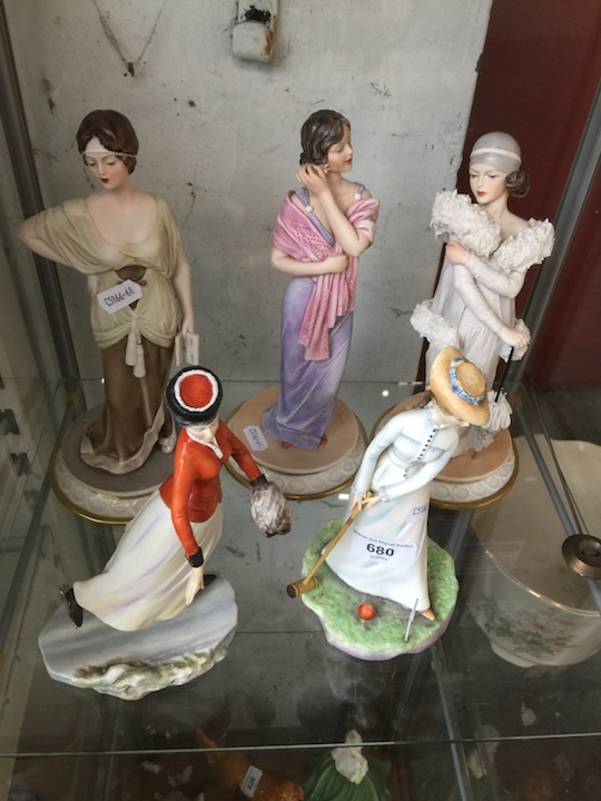 Lot 680 - Five Royal Doulton lady figurines