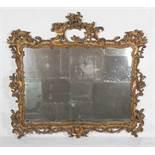 Large, carved and gilded cornucopia mirror. Circa 1930.