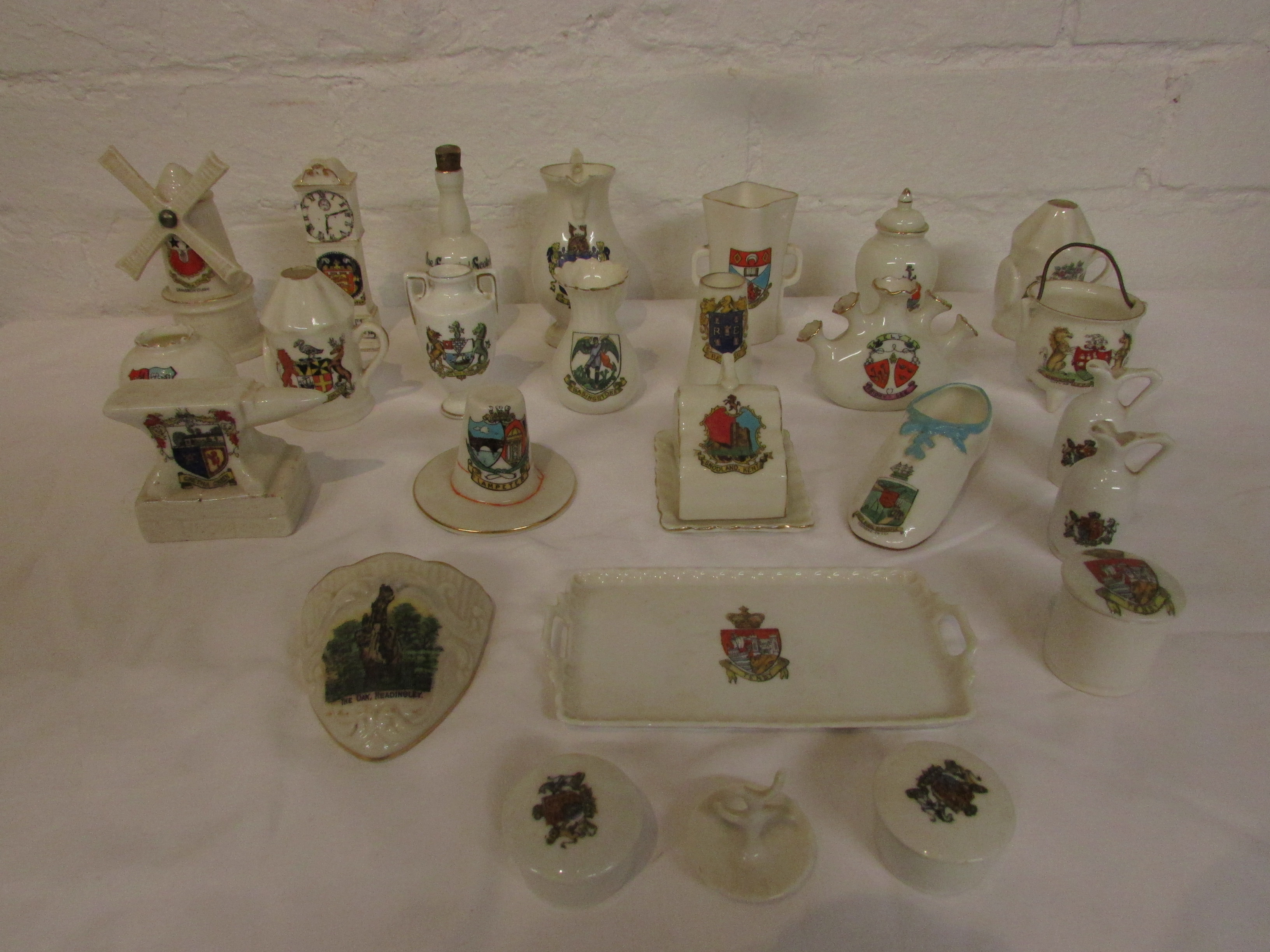 Lot 52 - Twenty-five items of crested china depicting various objects, windmill, clock, anvil etc - Goss,