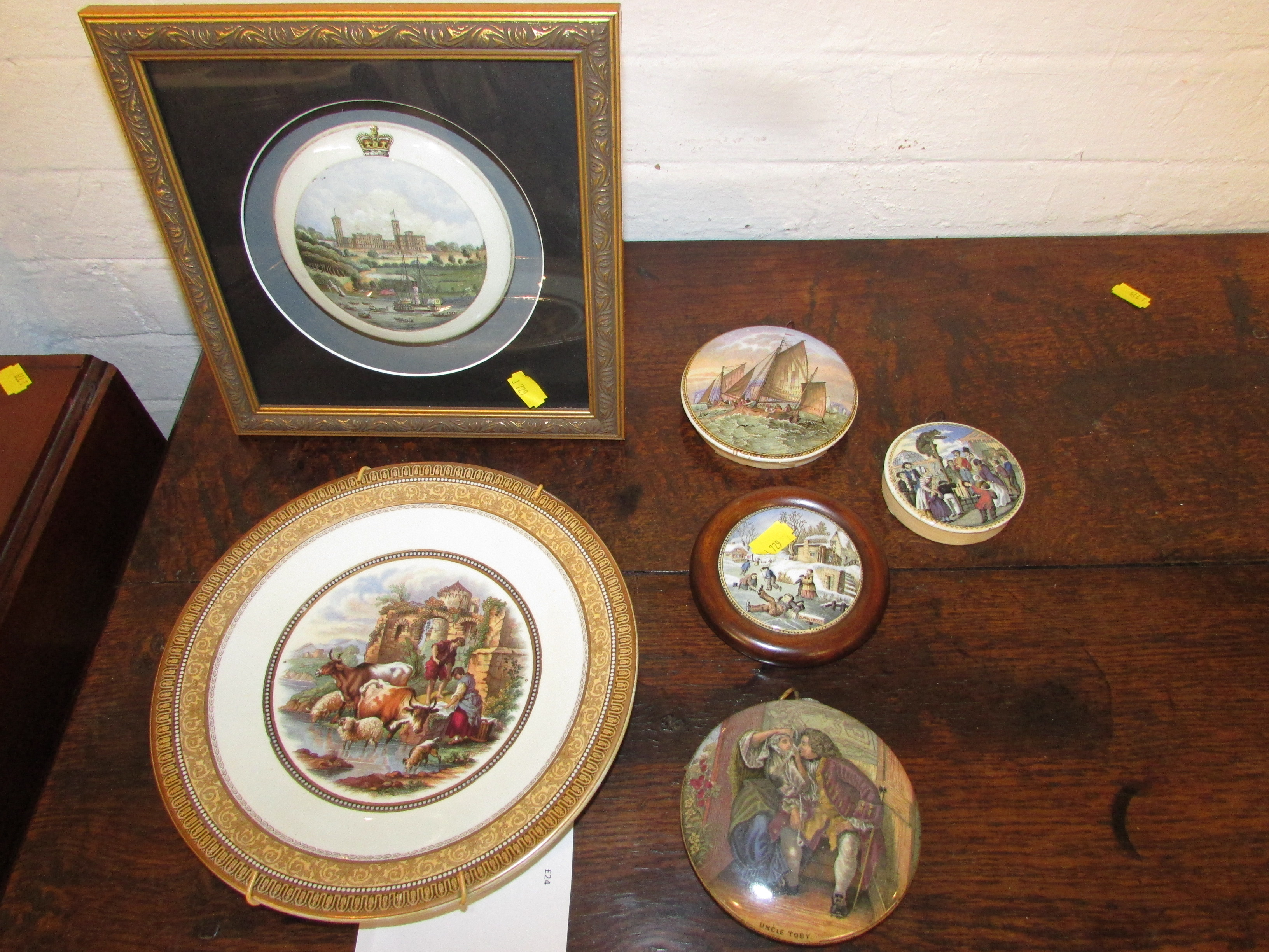 Lot 56 - A Pratt pot lid showing Royal Palace with paddle steamer to foreground with crown to the rim set