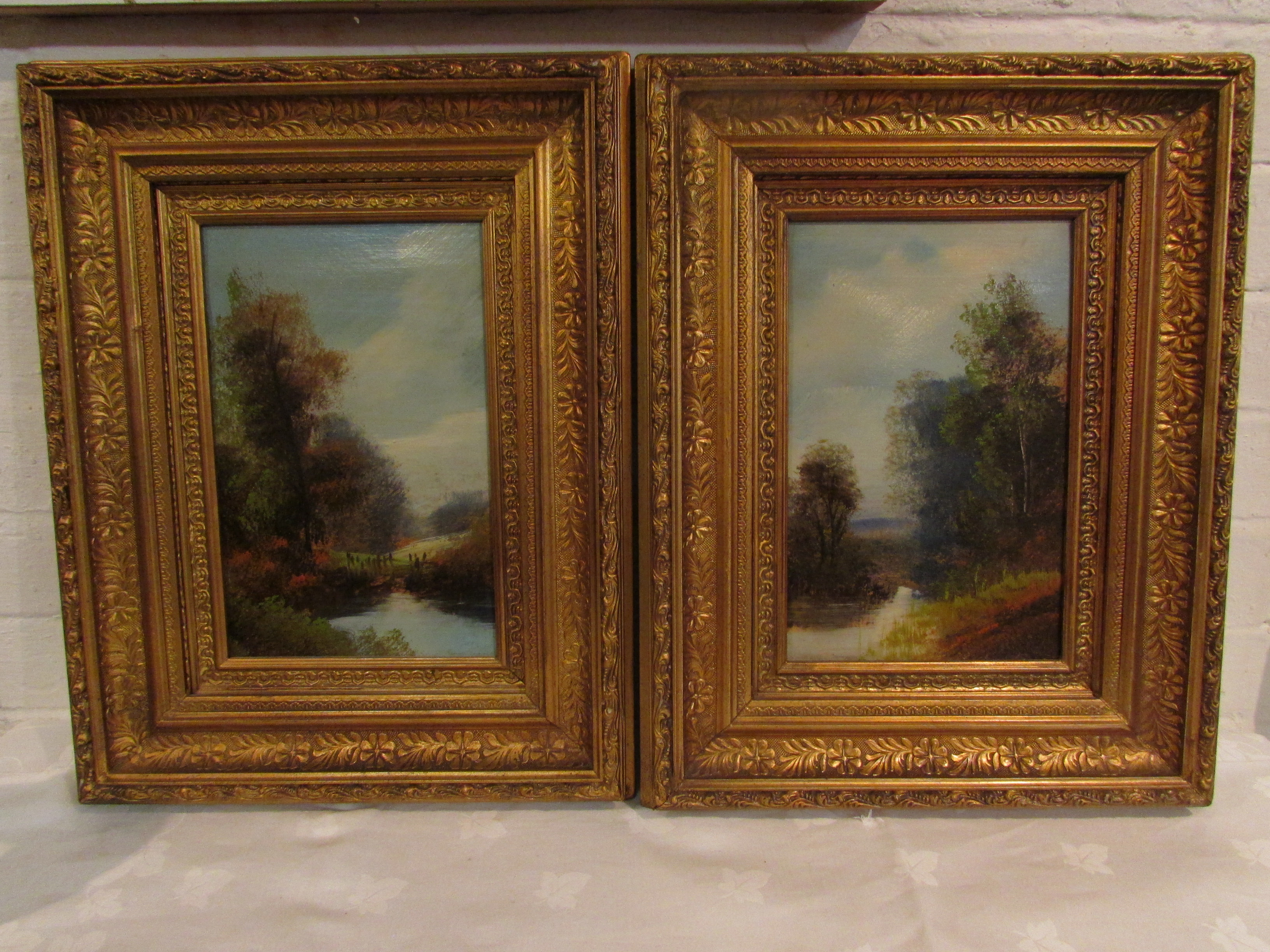 Lot 221 - Two corresponding oils on board of river scenes, each 27cm x 17cm in recessed moulded gilt frames