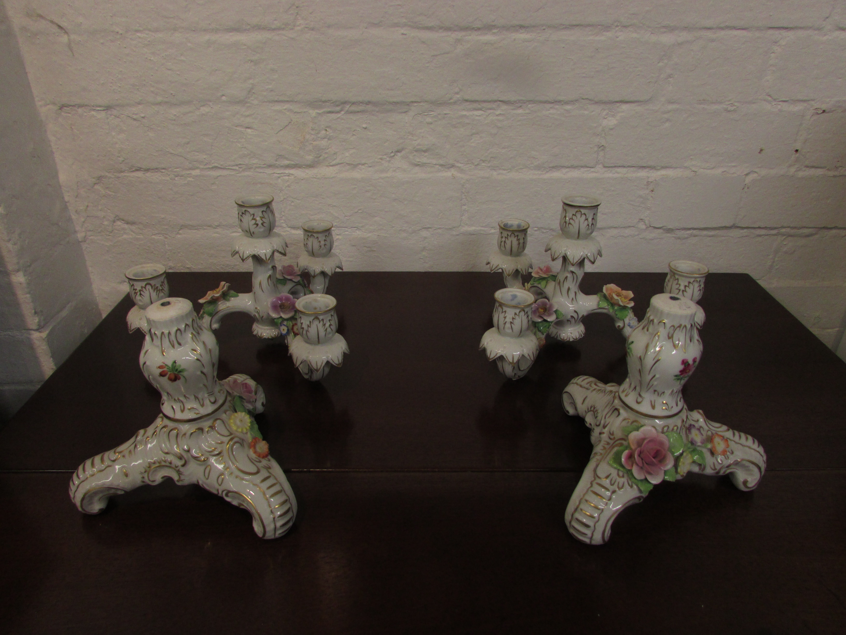 Lot 7 - Pair of Porzellan Manufaktur Plaue floral encrusted candle holders, three-branch with central
