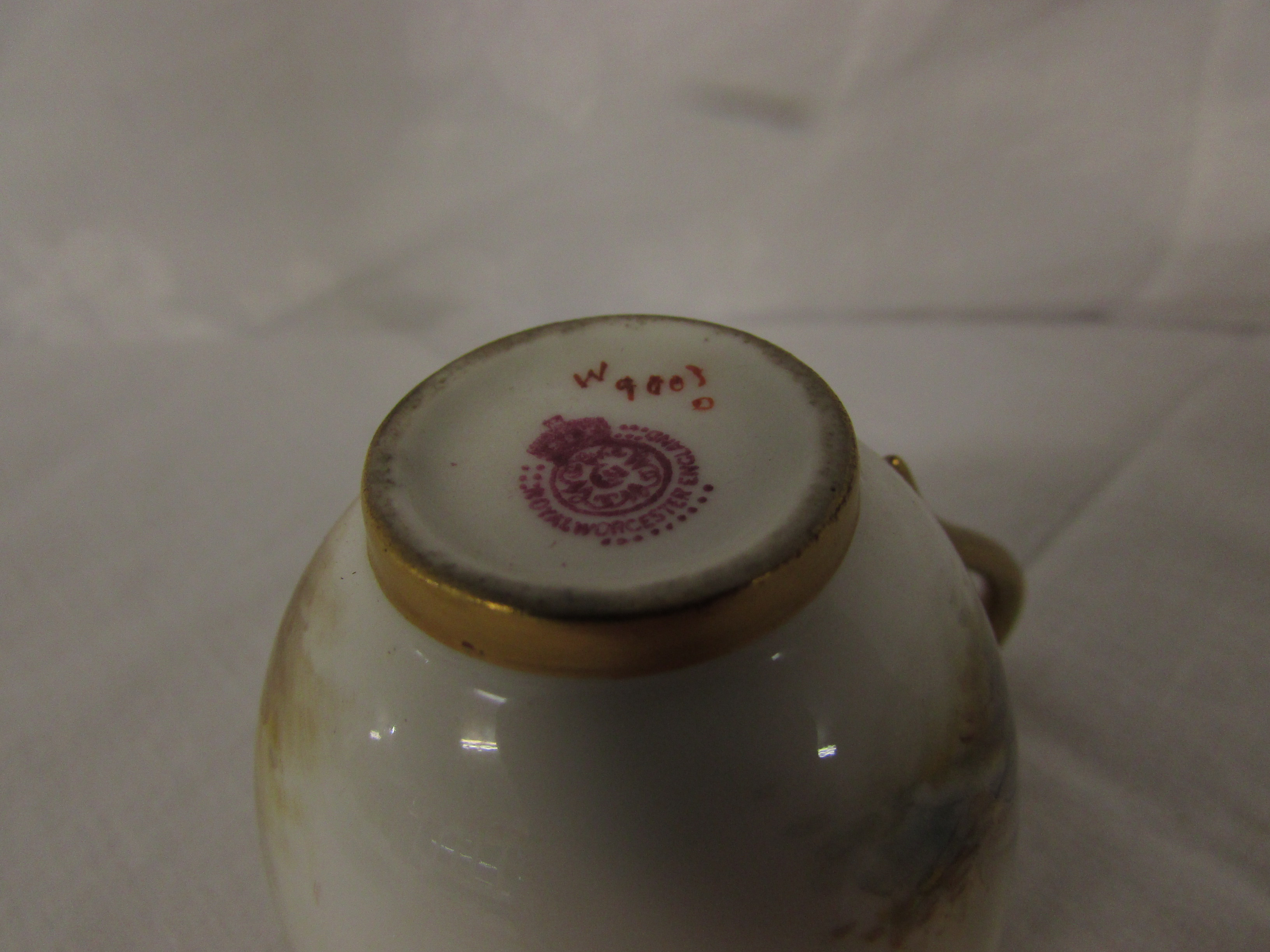 Lot 45 - Royal Worcester cabinet cup painted with cattle and signed H Stinton, gilding, puce factory transfer
