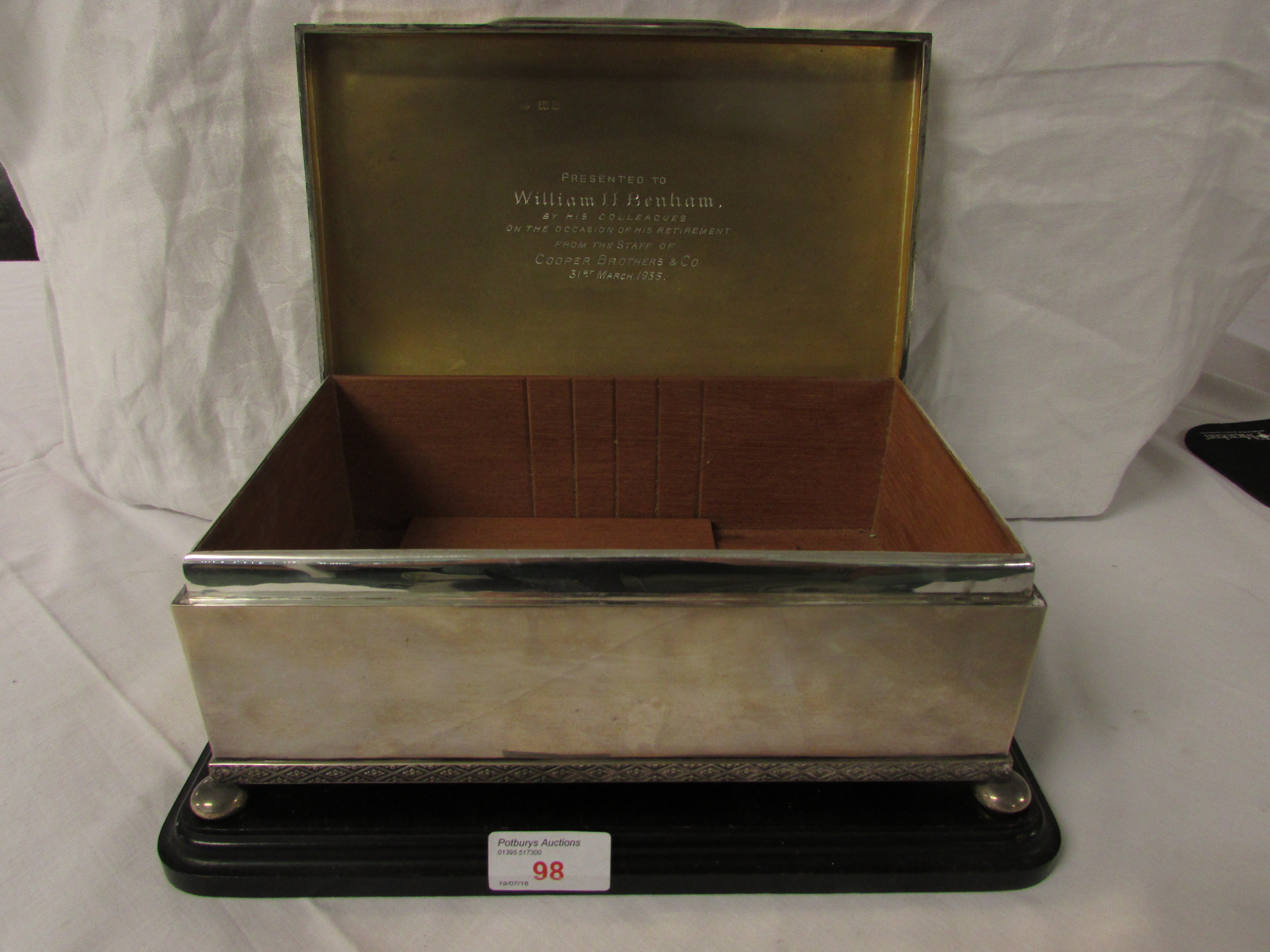 Lot 98 - A large George V silver cigarette casket, the hinged lid with engine turned bands and diaper
