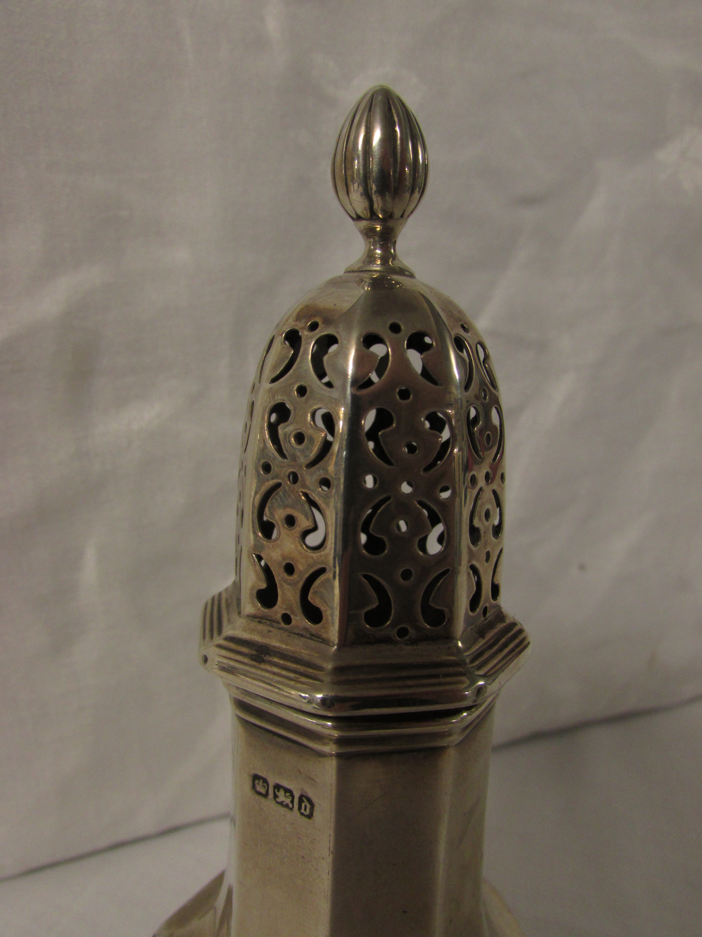 Lot 106 - A late Victorian silver sugar caster of octagonal baluster form, marks for Sheffield, 1896,