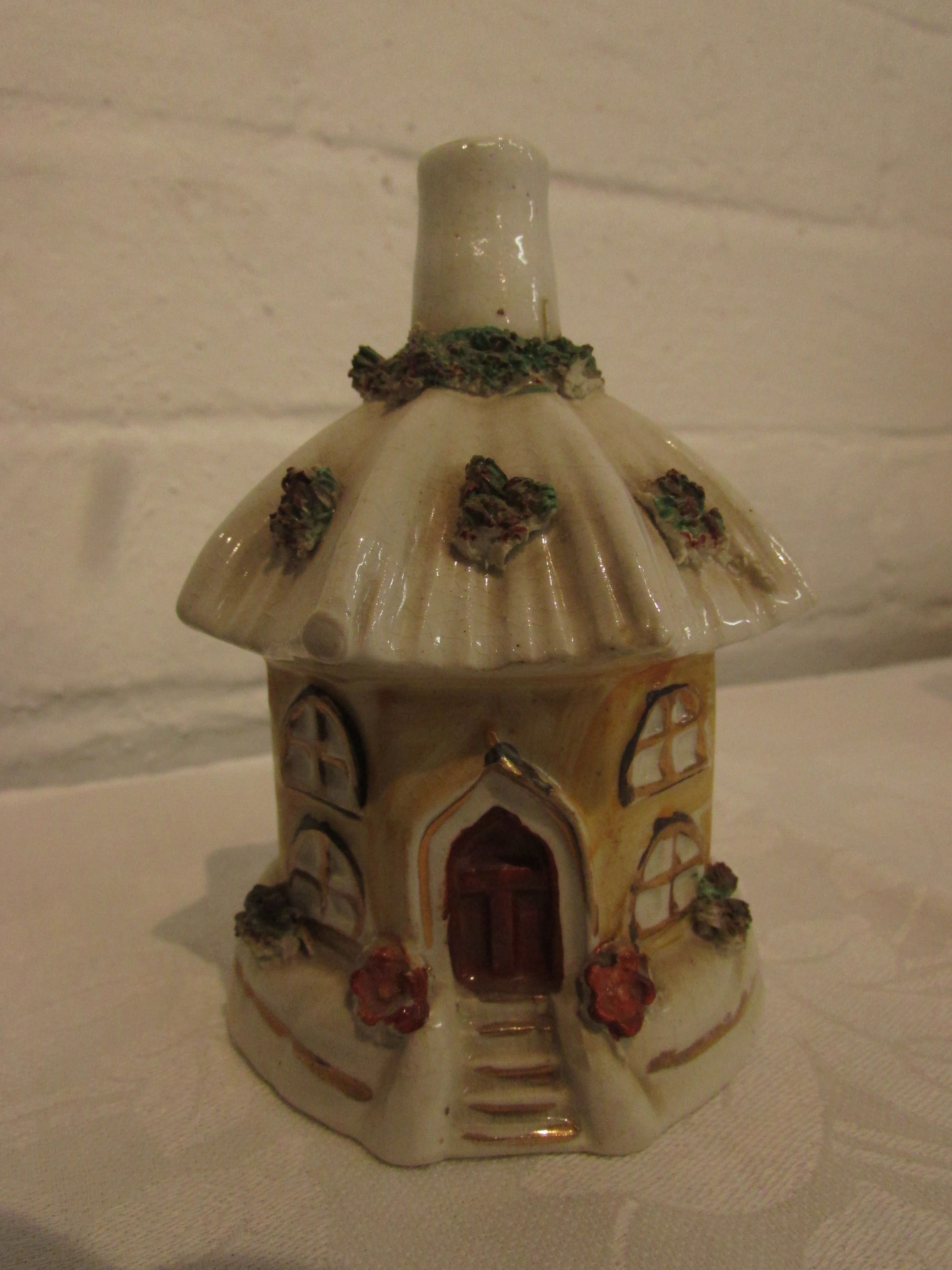 Lot 17 - 19th century Staffordshire pottery turreted castle pastille burner (height 15.5cm), a