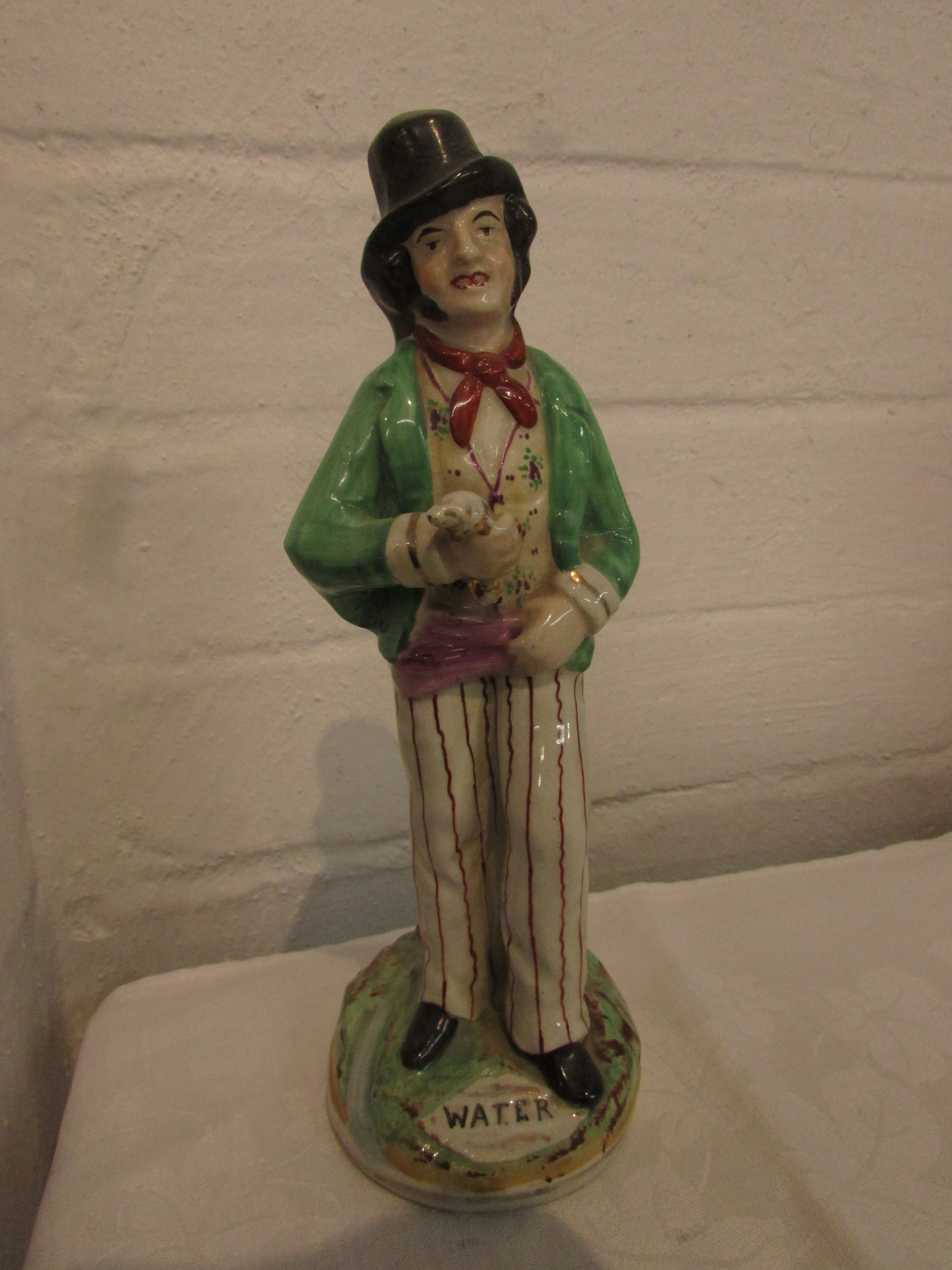 Lot 5 - 19th century double-faced Staffordshire pottery figure 'Gin and Water', height 22cm