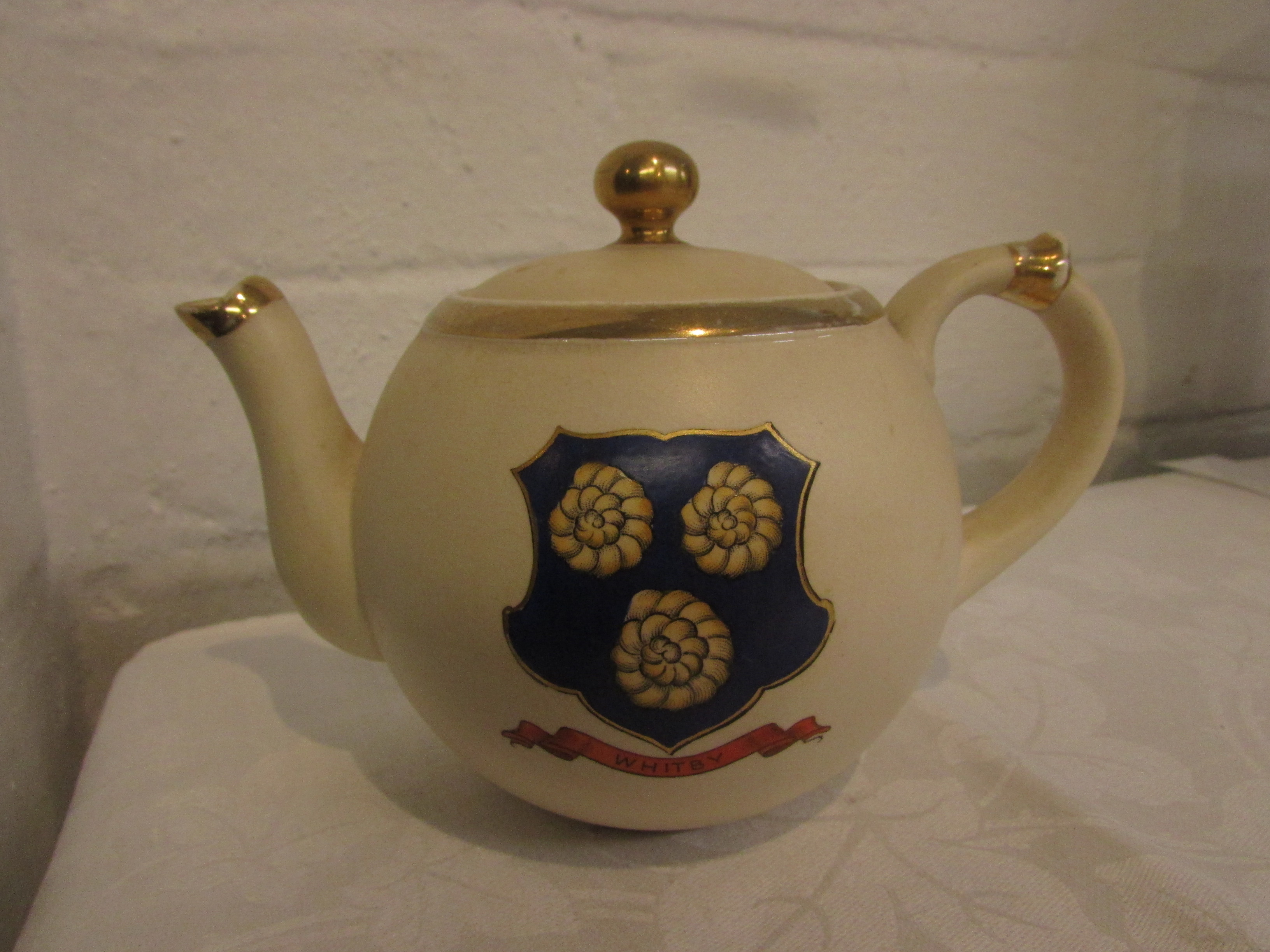 Lot 49 - MacKintyre teapot bearing coat of arms for Whitby, brown transfer factory mark, Rd No 294478