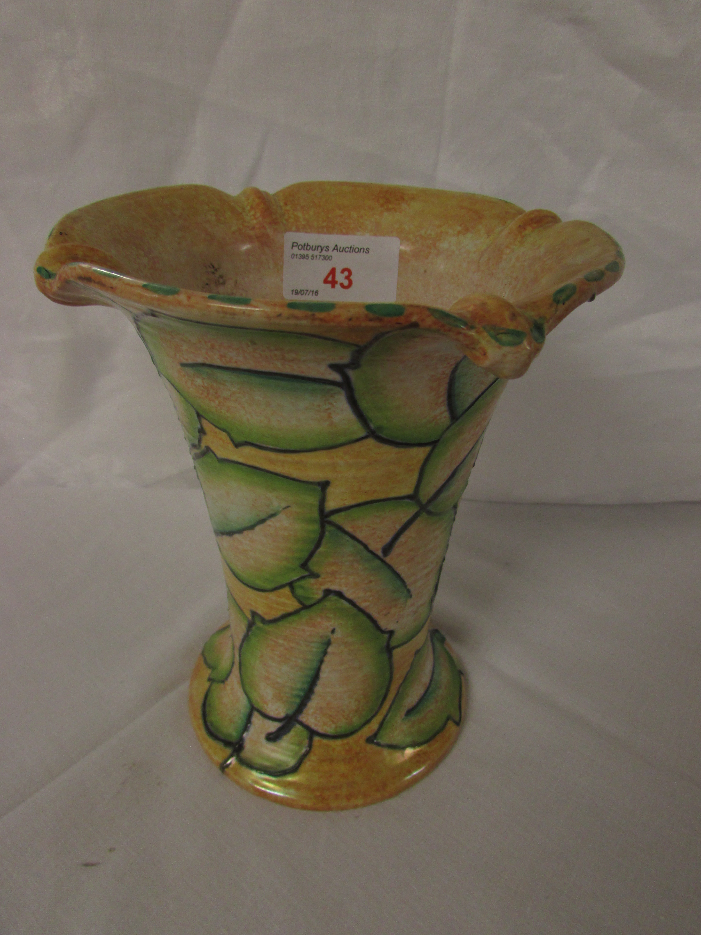 Lot 43 - A Burleigh vase signed Bennett, yellow painted with green stylized leaves, of flared form with