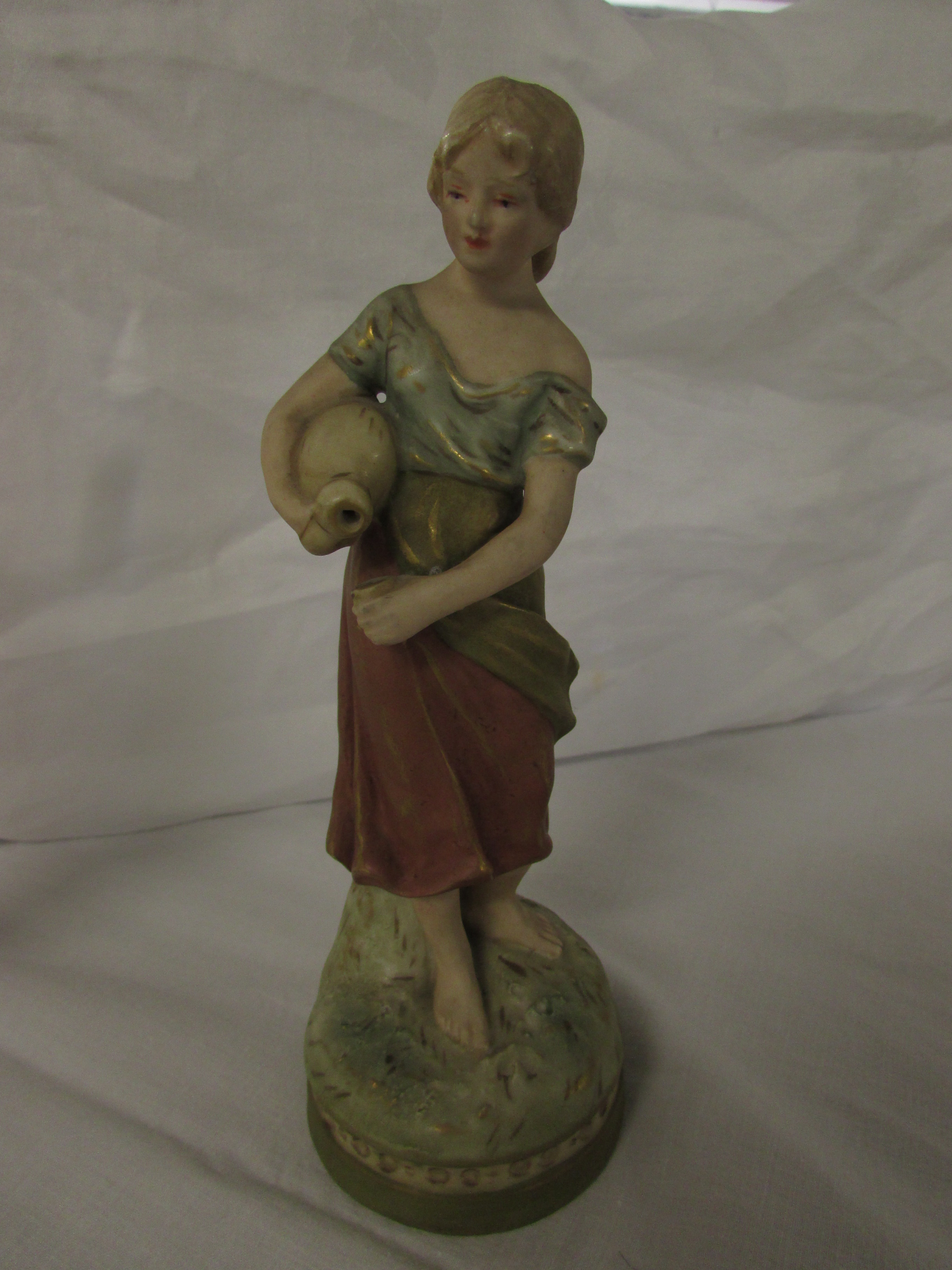 Lot 34 - Two corresponding Royal Dux figures of young man and woman with flasks and drinking cups, on