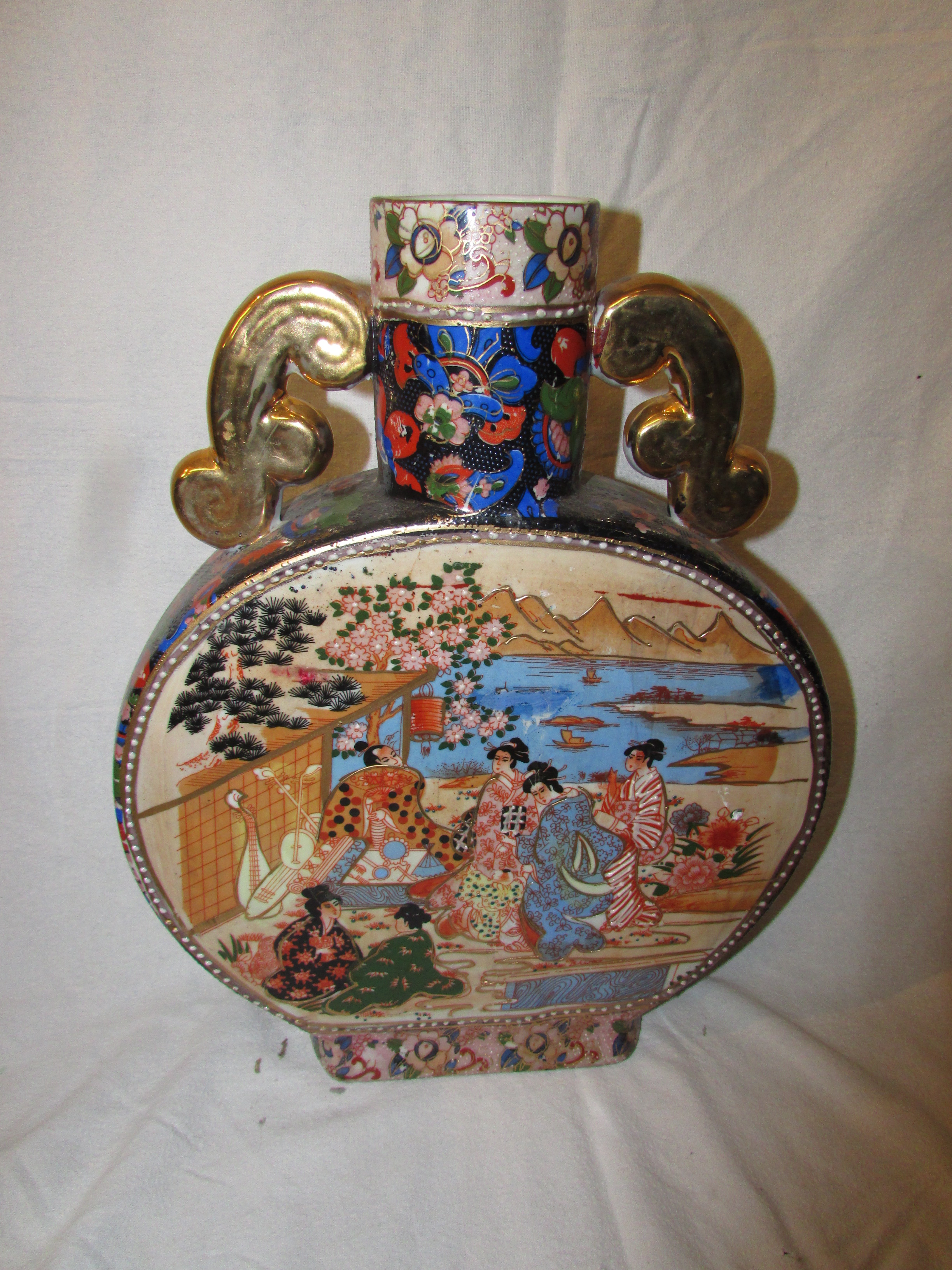 Lot 22 - 20th century Chinese porcelain moon flask, transfer decorated with figures in garden scenes,