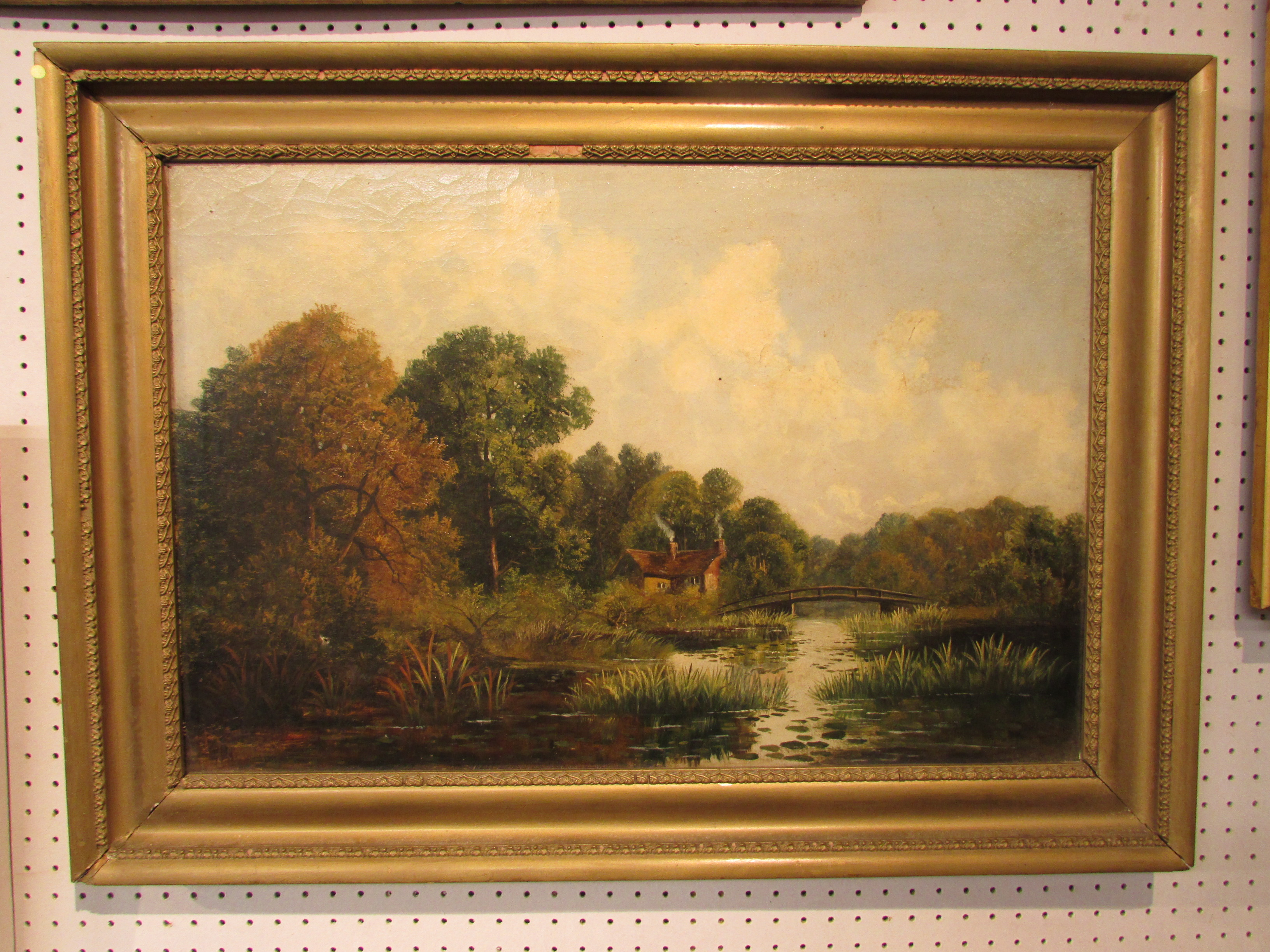 Lot 240 - Oil on canvas river landscape, indistinct signature lower left, (39cm x 59cm), in a gilt frame,