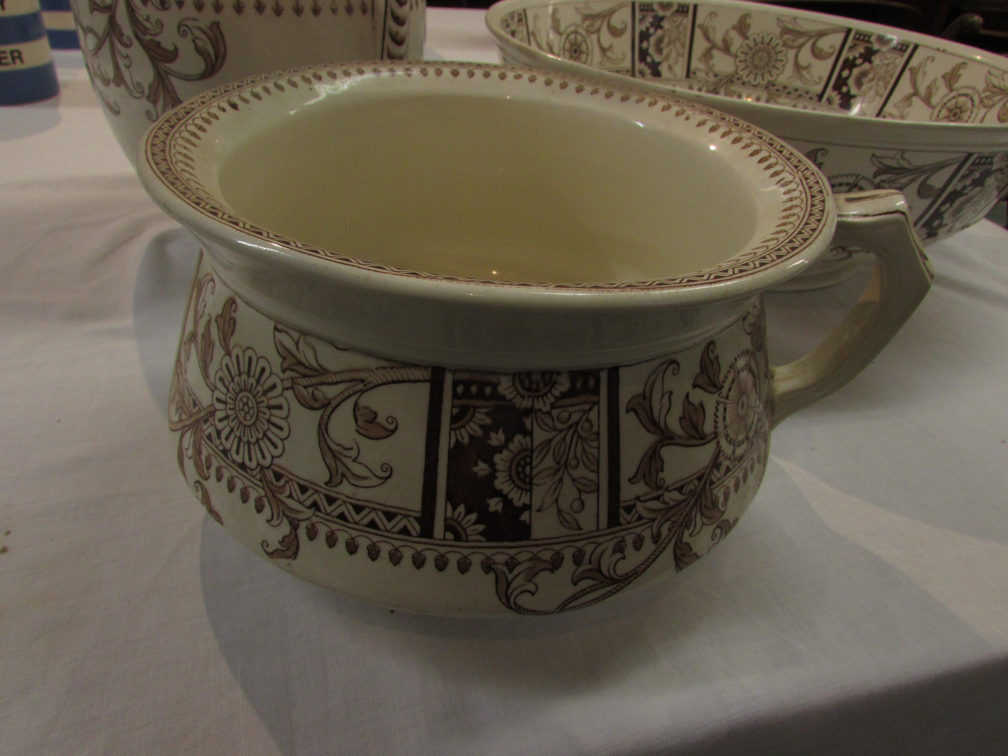 Lot 20 - Pottery toilet set comprising bowl (diameter 38.5cm) jug (height 29.5cm) and chamber pot, buff