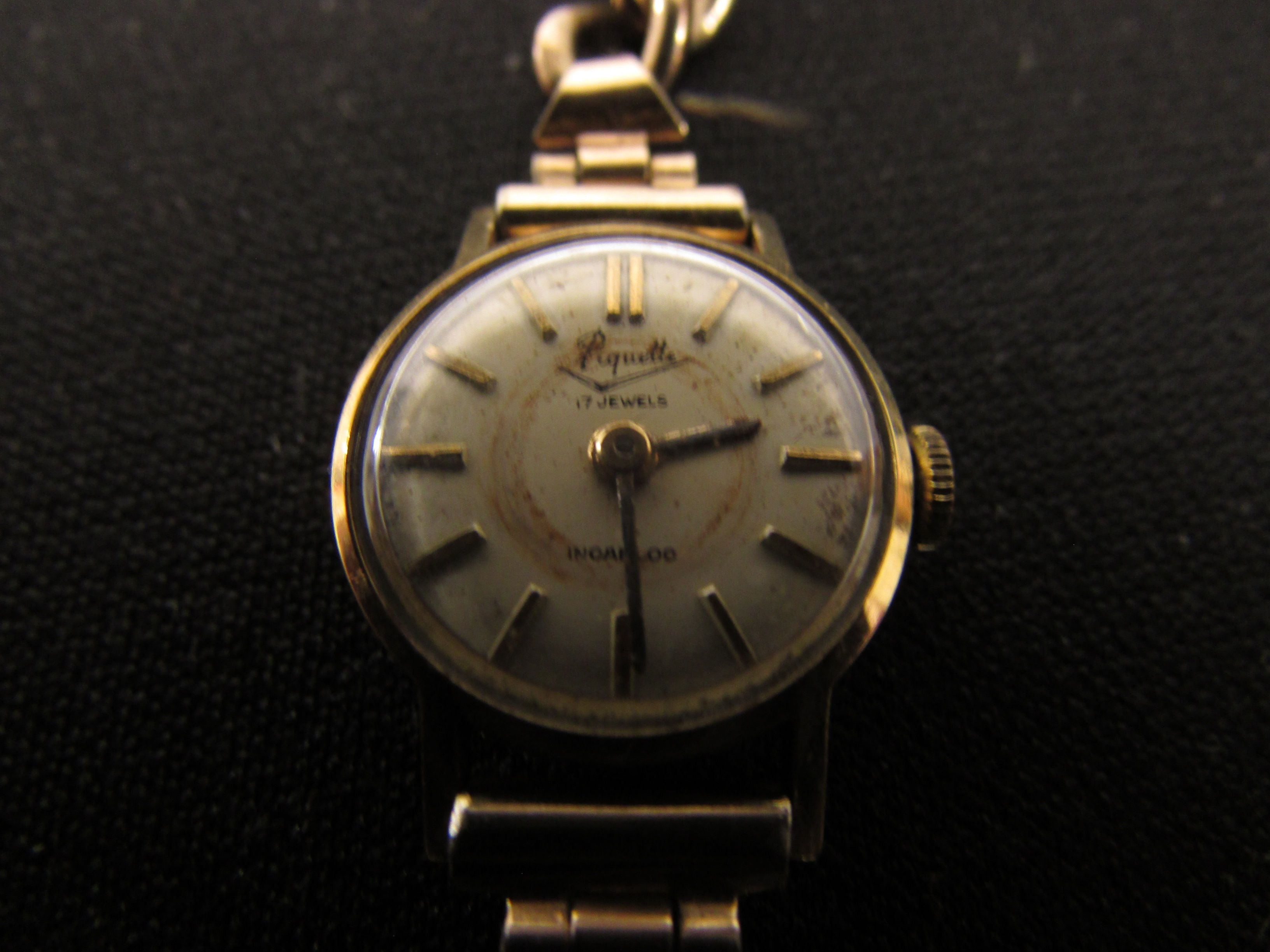 Lot 124 - Ladies Piquette cocktail wristwatch with incabloc movement and baton numerals in a 14KT gold
