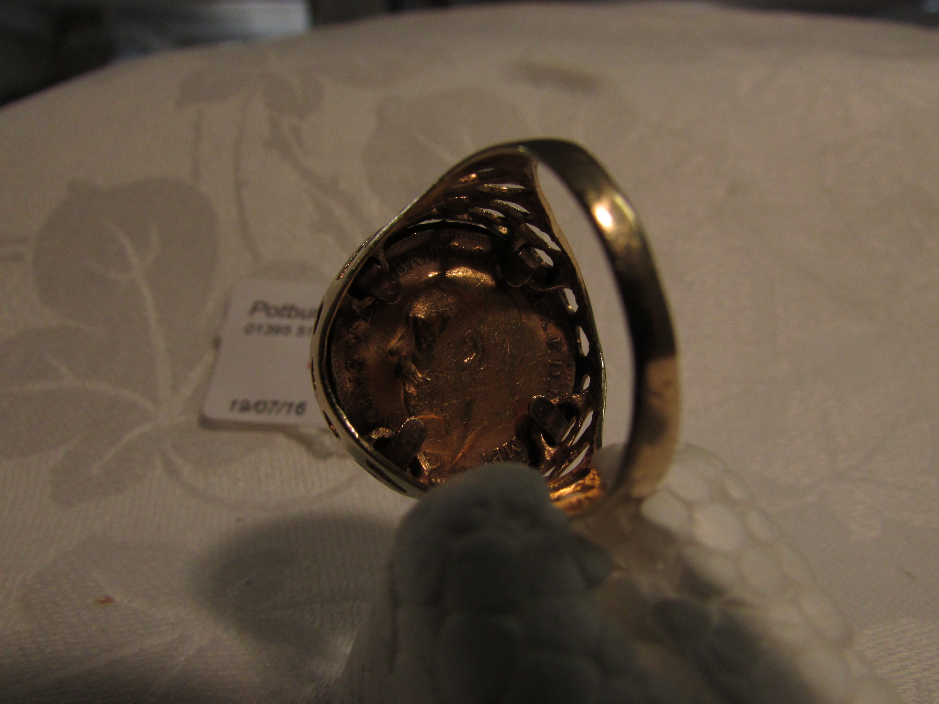 Lot 163 - 9ct gold gentleman's ring set with a 1914 half sovereign, 7.2g