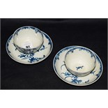 Lot 91 - A pair of first period Worcester tea bowls and saucers, floral spray decoration, marks to base.