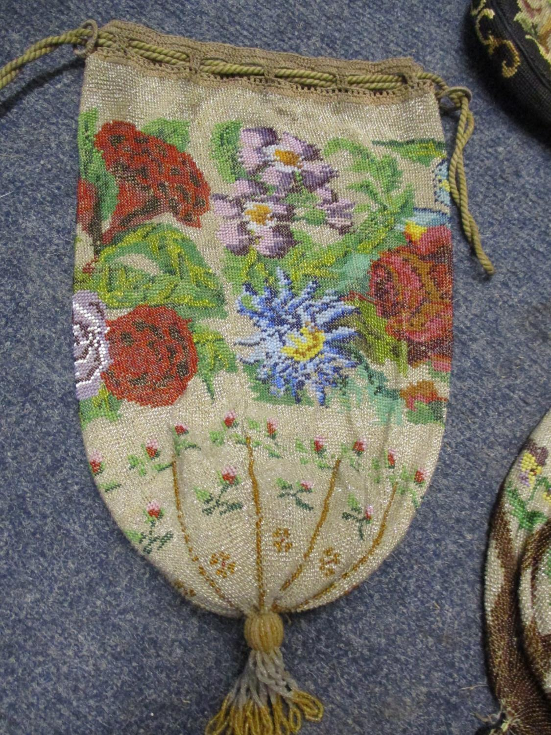 Two mid 20th century oriental style parasols depicting tulips, together with an early 20th century - Image 4 of 4