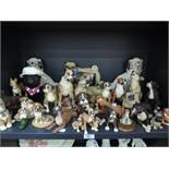 A selection of boxer dog figures and similar items