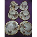 A selection of hand decorated tea cups and saucers by Hammersley