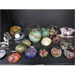 A selection of clear and colour glass paper weights including Caithness and Mdna
