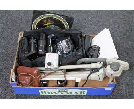 A box of camera bag and tripod, assorted digital cameras, telephoto lens, Philips Planisphere