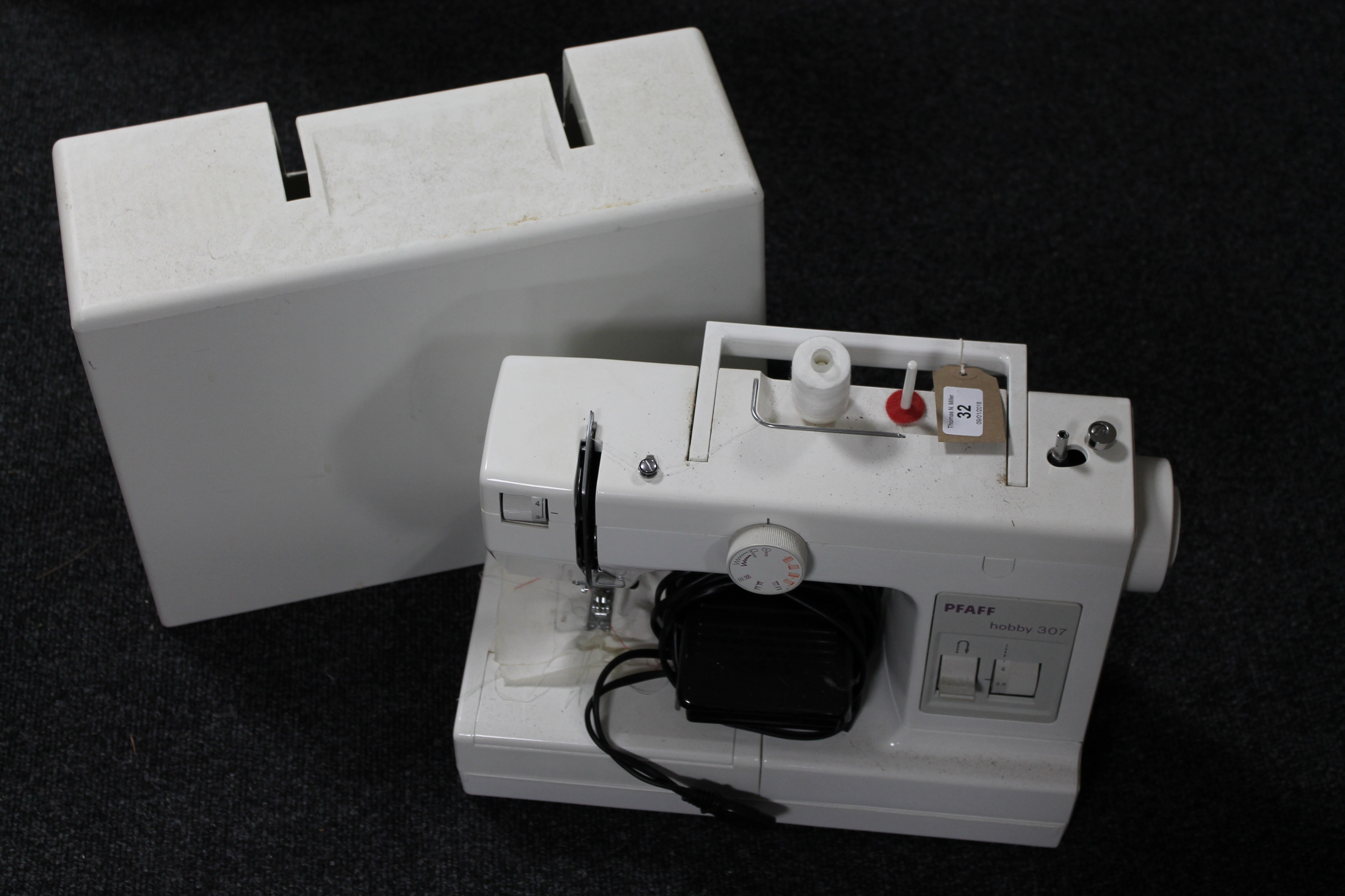 Lot 32 - A Pfaff hobby 307 electric sewing machine