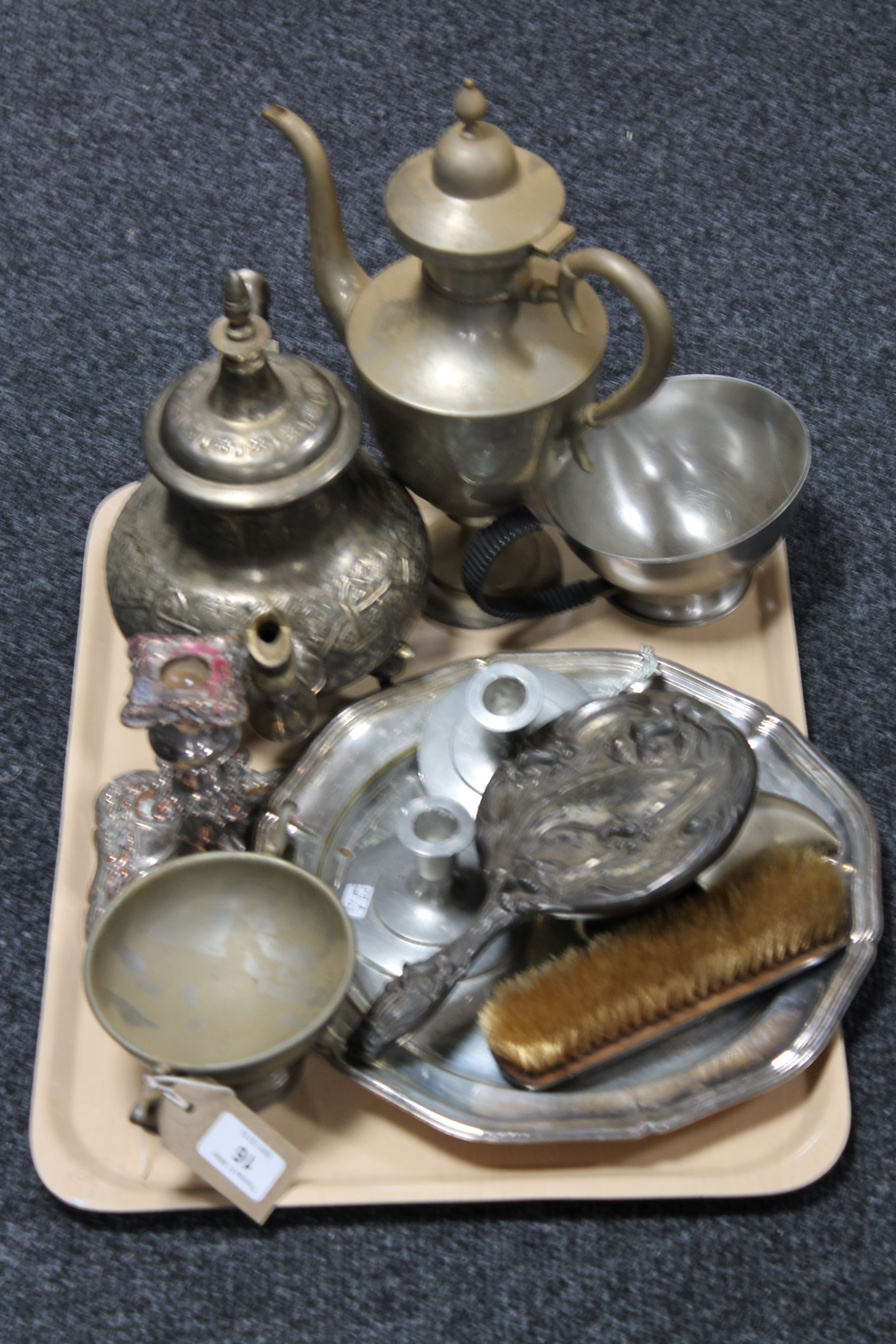 Lot 16 - A tray of twentieth century plated ware including teapots, candlesticks,