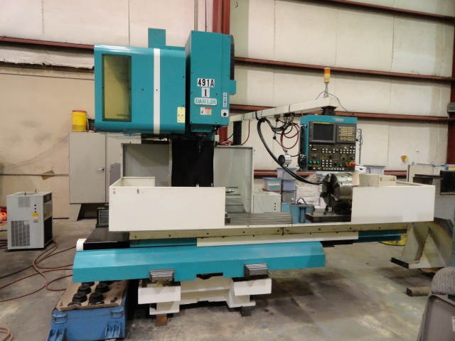 "Lot 55 - CNC VERTICAL MACHINING CENTER, DAHLIH MDL. MCV-1500, new 11/2005, Fanuc 21iMB CNC control, 67"" x"