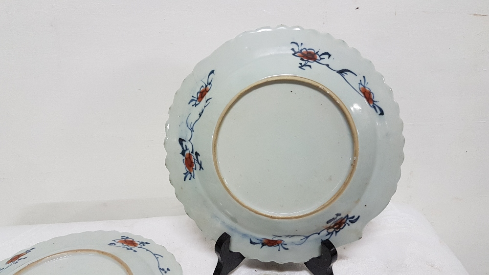 "Lot 44 - Matching pair of glazed Japanese ironstone cabbage leaf plates, 9""dia with matching stands, floral"