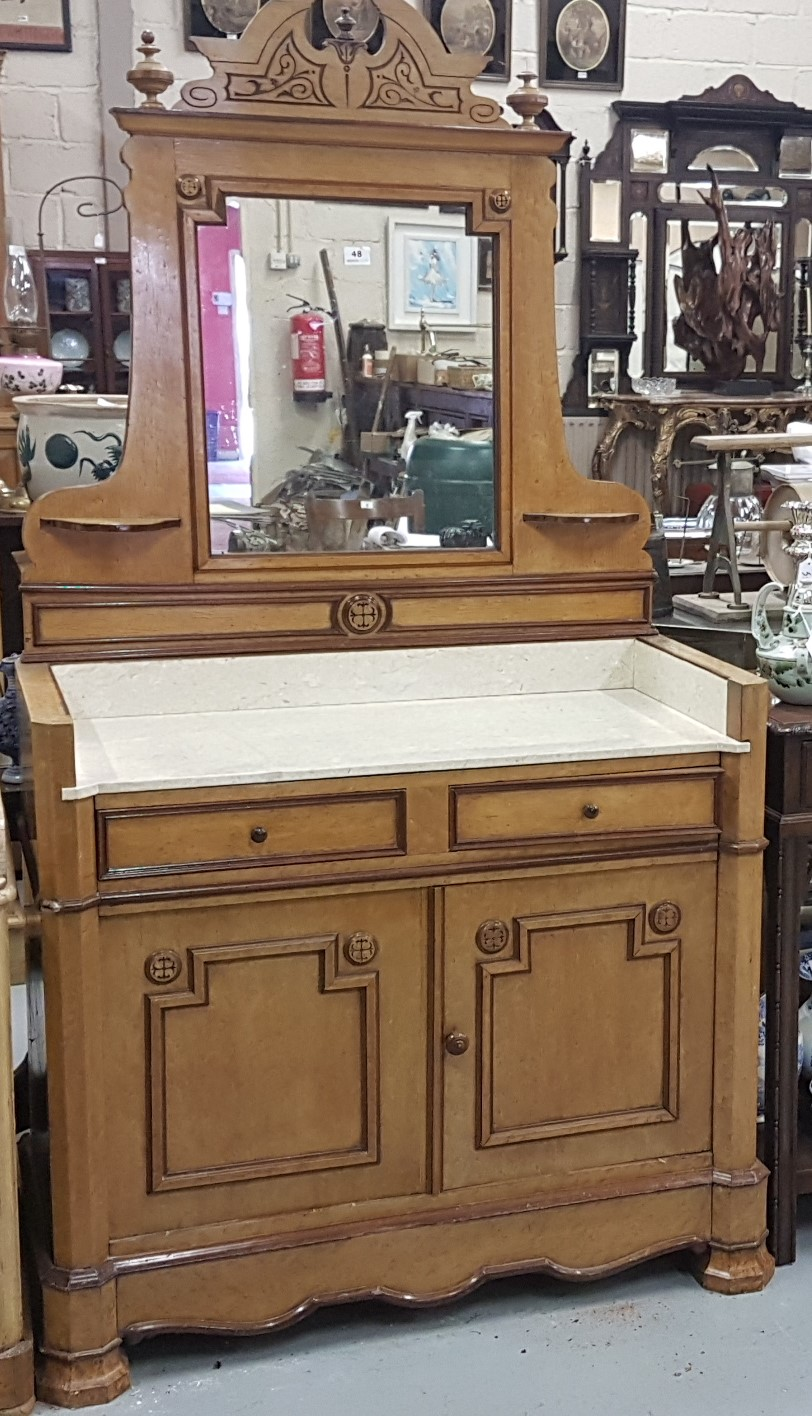 Lot 48 - Gothic Oak Dressing Table, with a mirror back and beige marble top, two short drawers and two