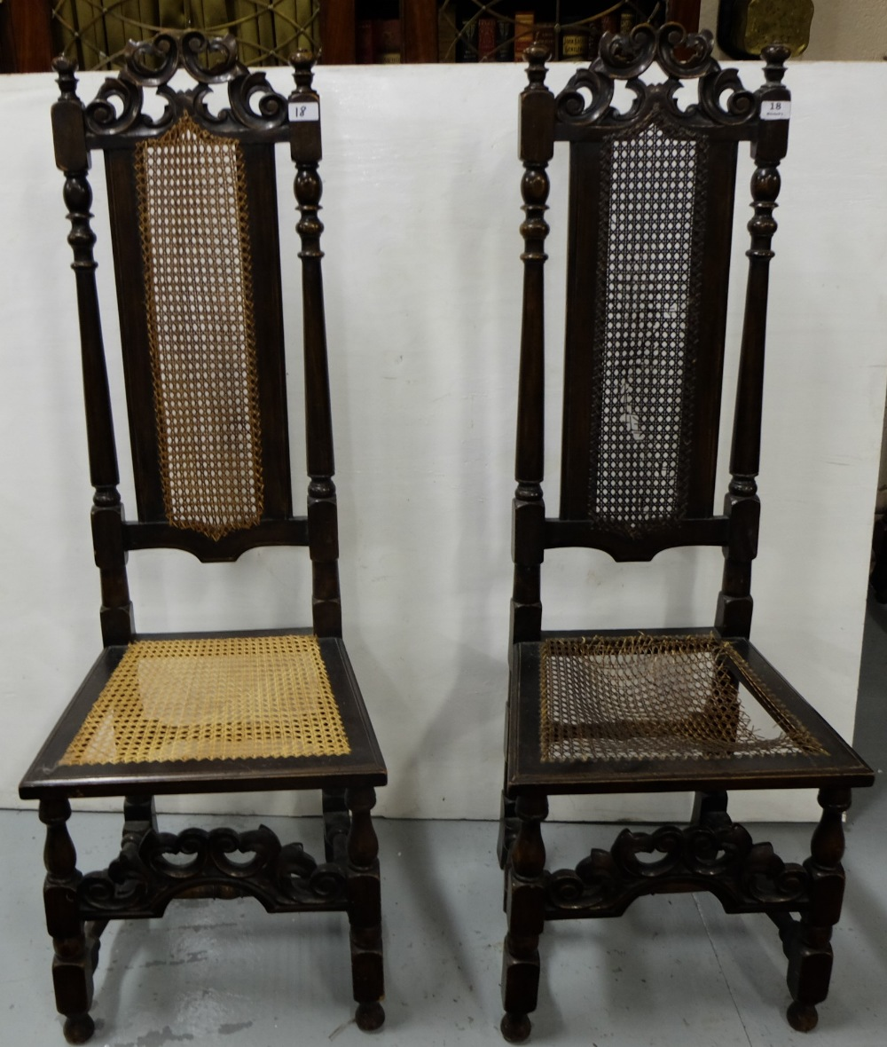 Lot 14 - Matching pair of carved oak highback hall chairs, bergere seats and backs (one seat damaged)