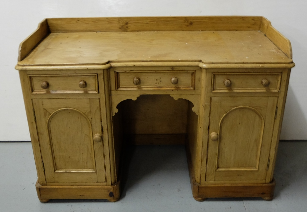 """Lot 43 - Stripped antique pine kneehole desk, with 2 side cabinets and 3 gallery drawers, 46""""w x 31.5""""h x"""