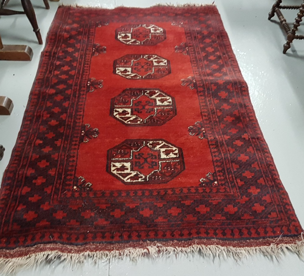 Lot 29 - Persian wool ground red rug, bacarra pattern on a woollen back, 1.85m x 1.05m