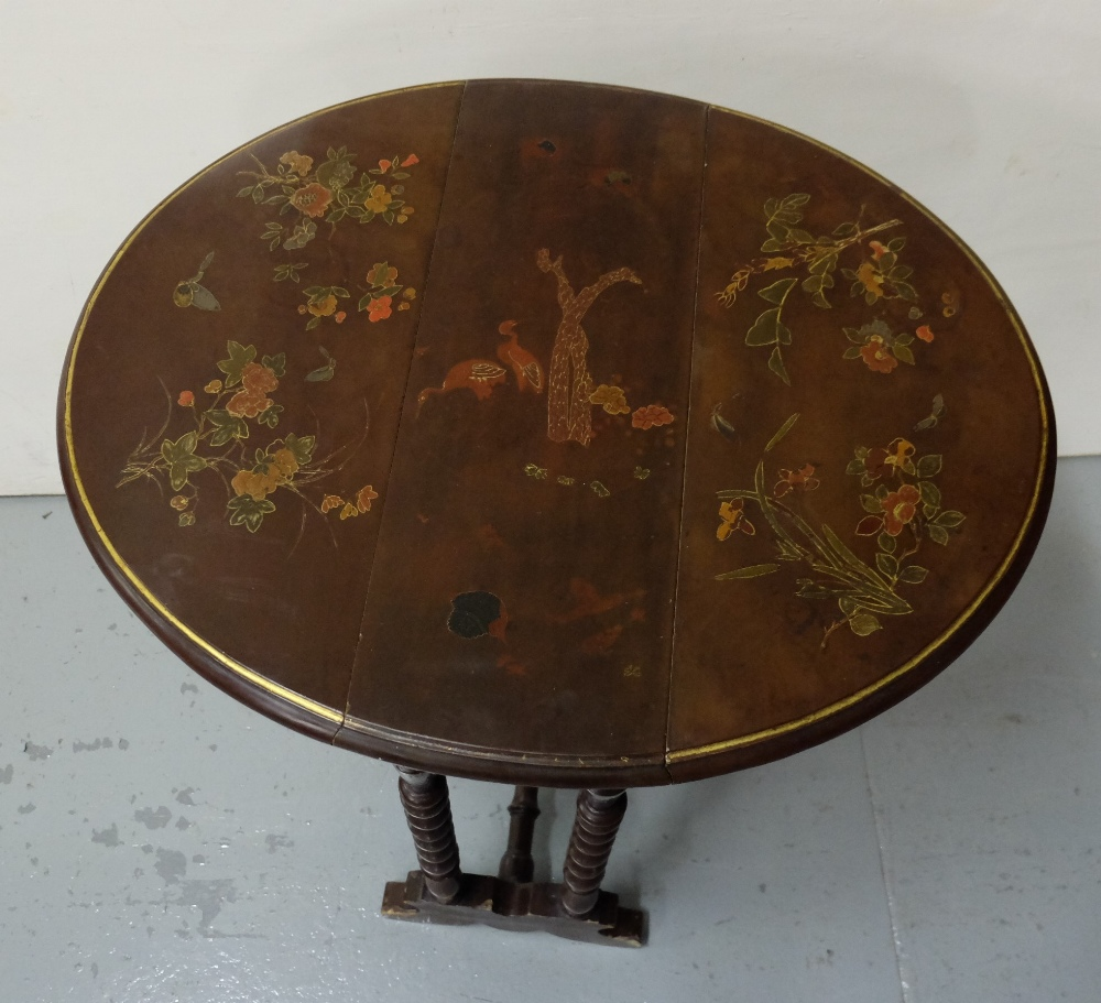 """Lot 12 - Chinoiserie Sutherland Table with bobbin shaped legs, with raised floral patterns, 22"""" d, extends to"""