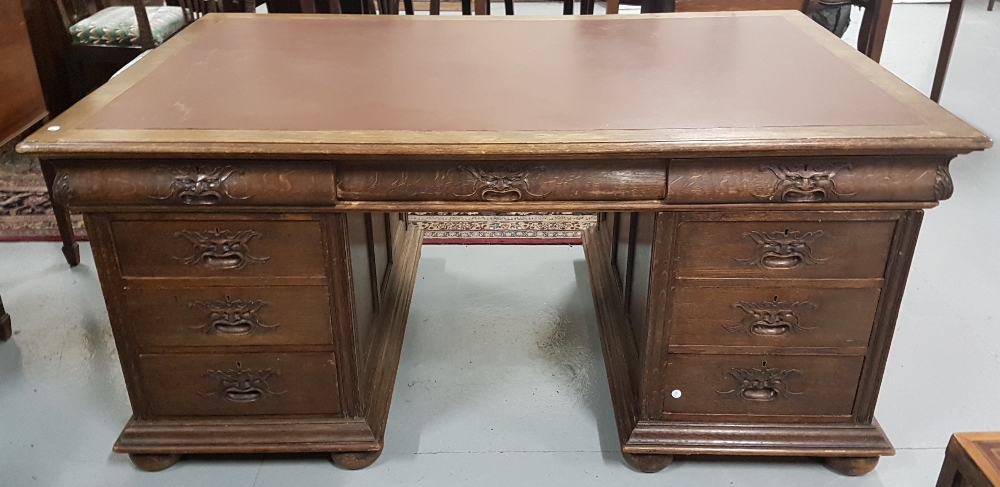 Lot 92 - Carved oak kneehole partner's desk, with 3 apron drawers over 3 small drawers, with masked